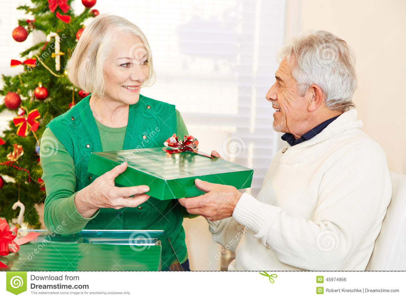 senior citizens celebrating christmas with gifts