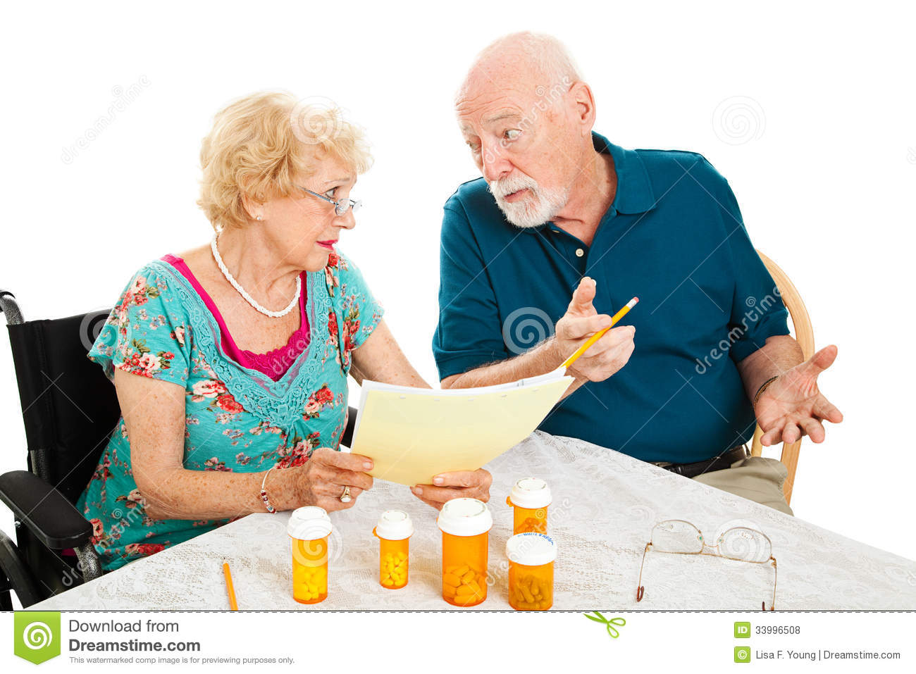 Senior Couple Discussing Medical Expenses Royalty Free