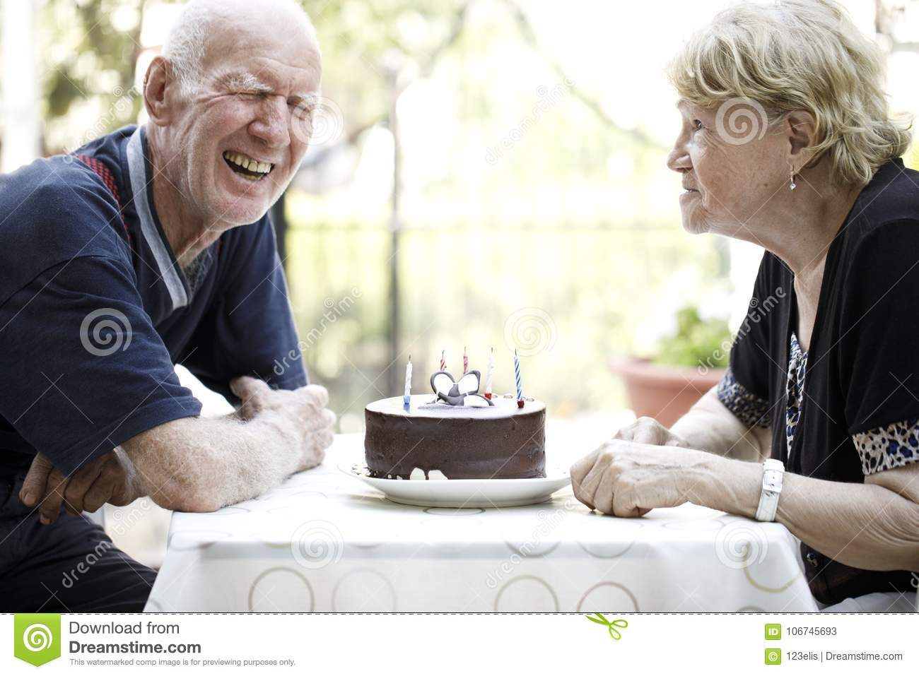 Senior Couple Eating Birthday Cake