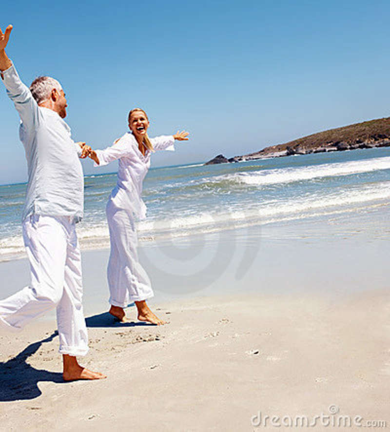 Couple At The Beach Stock Image Image Of Caucasian: Senior Couple Fooling Around On The Beach Stock Photo