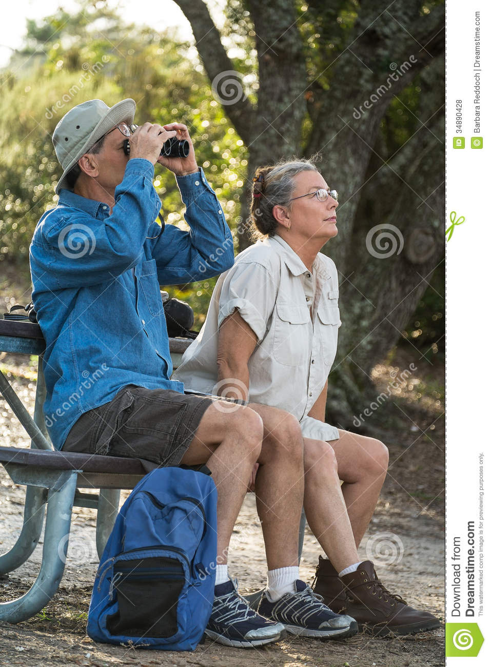 Senior Couple Hiking Birdwatching And Camping Royalty