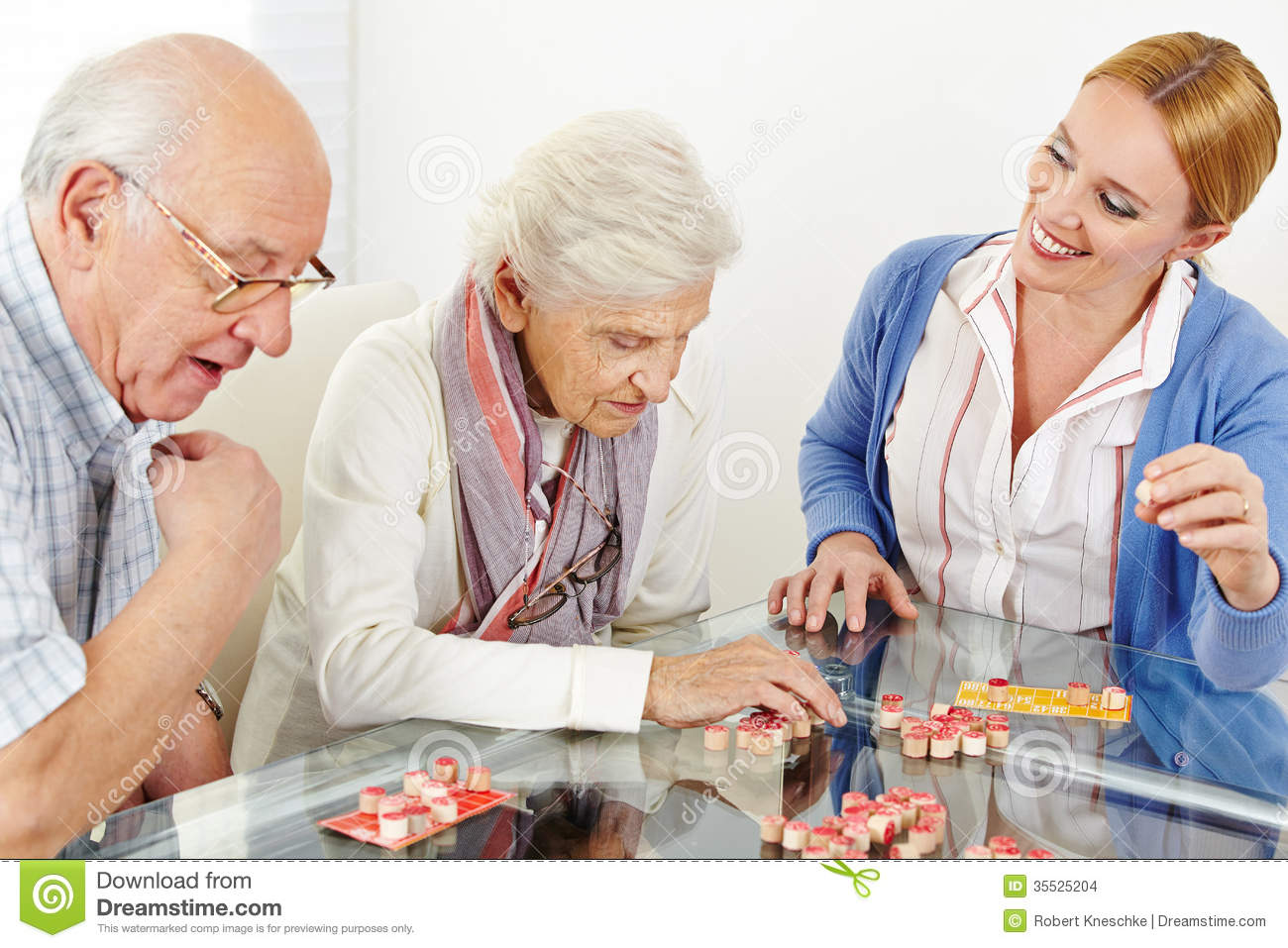 senior couple playing bingo stock photo image of care