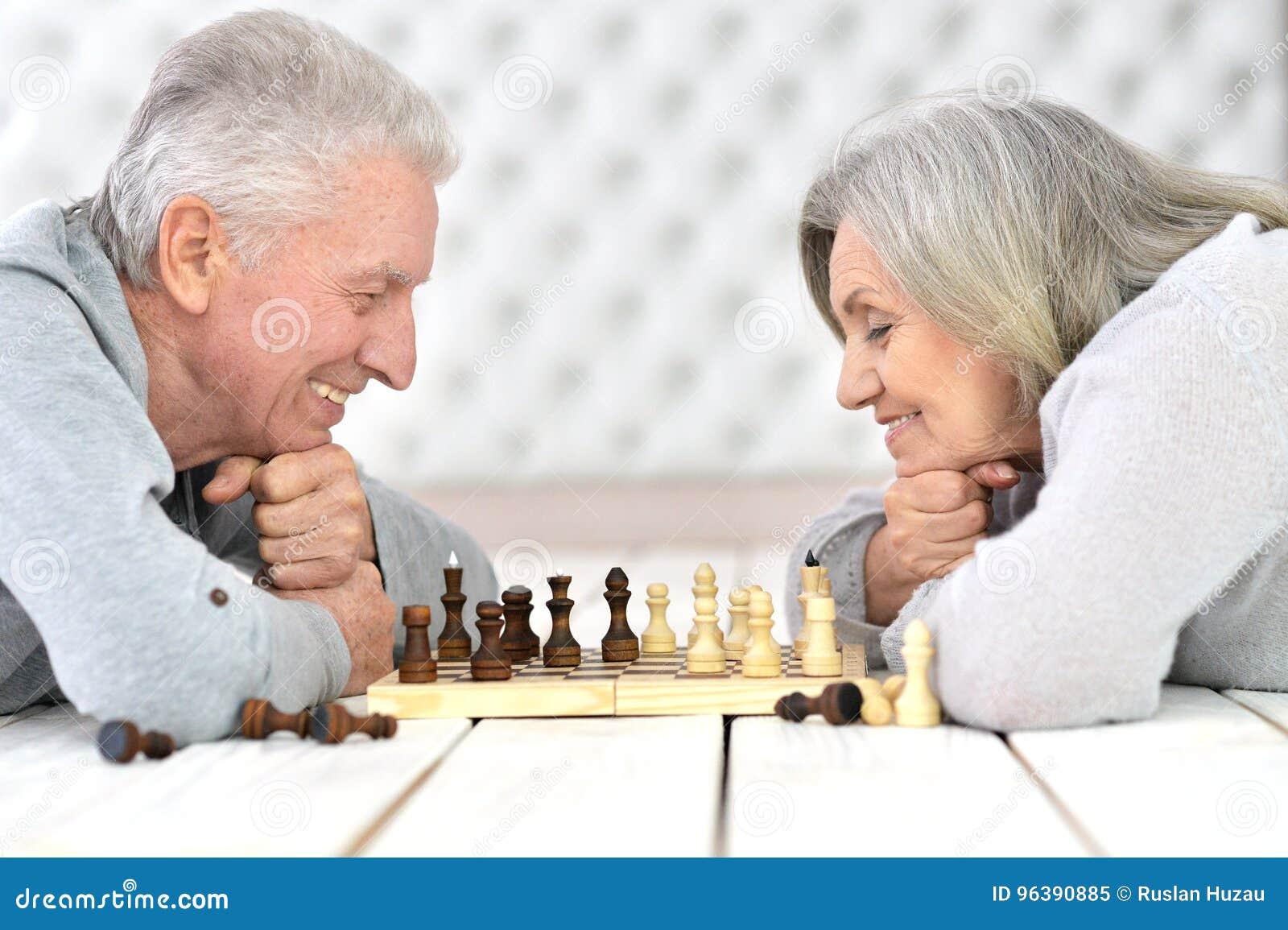 Senior couple playing chess