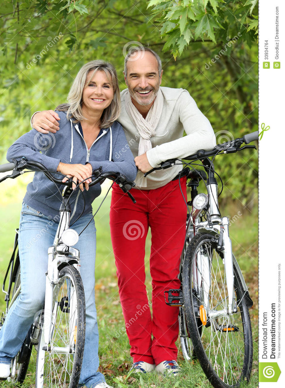 Senior couple relaxing after riding bicycle