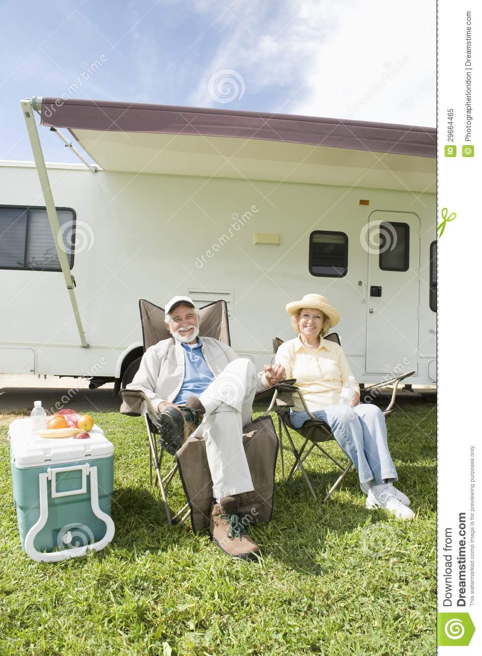 senior couple sit outside rv home royalty free stock photo. Black Bedroom Furniture Sets. Home Design Ideas