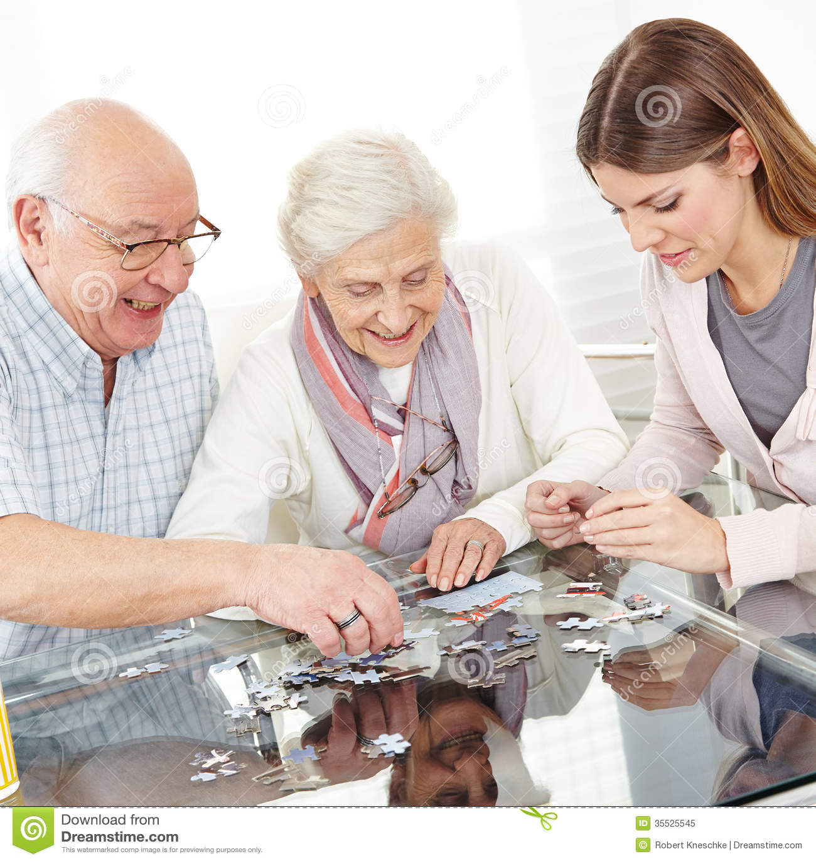 Senior couple solving jigsaw puzzle
