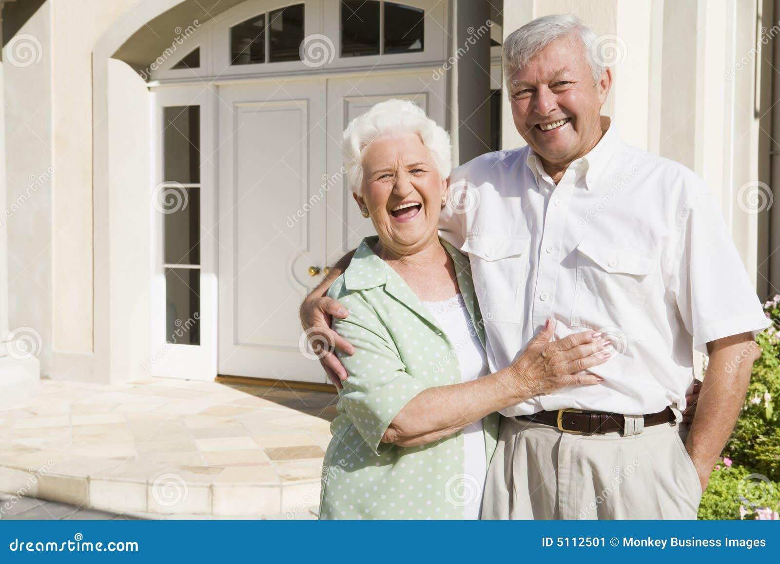 Senior couple standing outside house stock image image for Seniors house