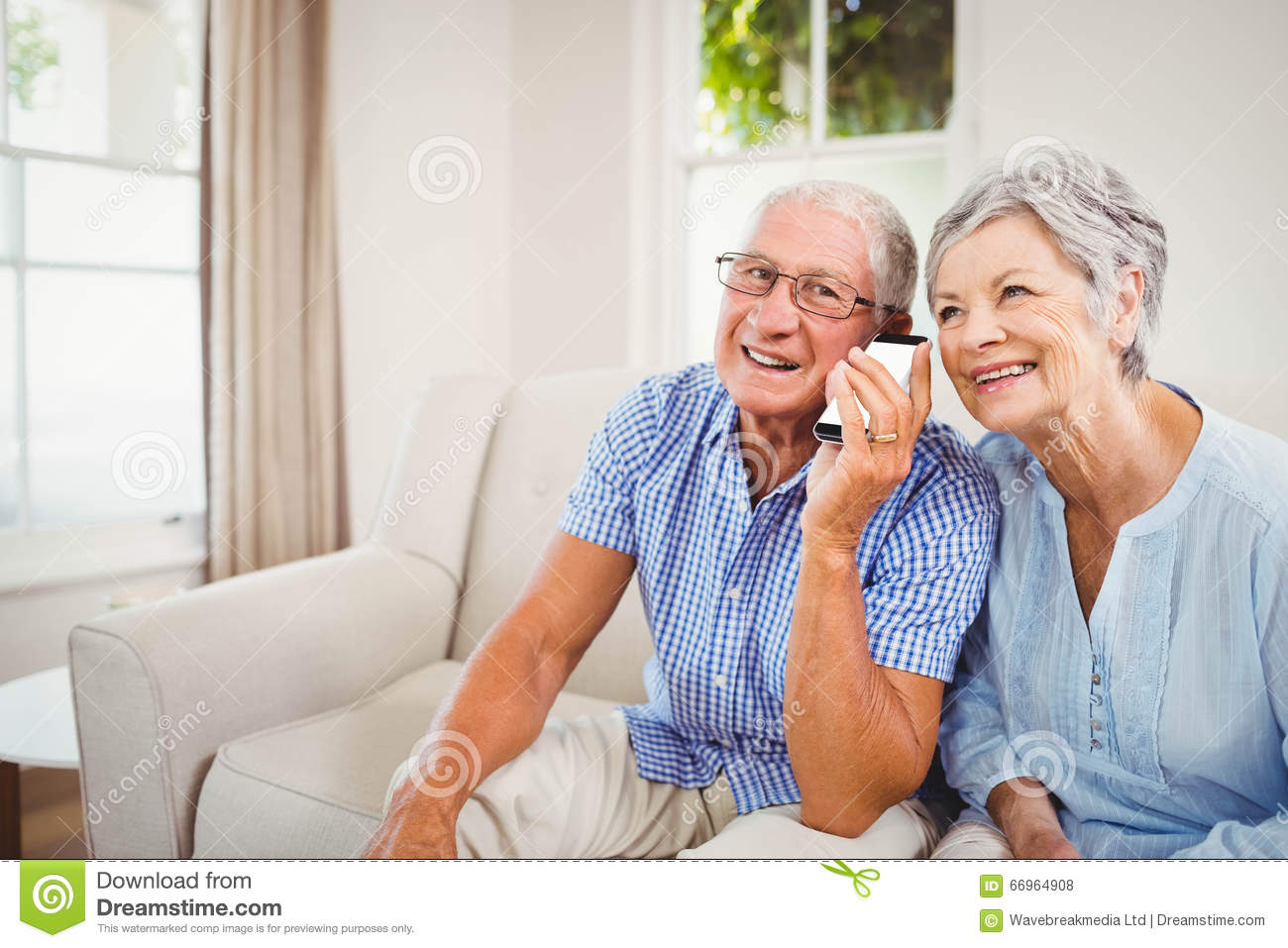 Senior Couple Talking On Mobile Phone Stock Photo - Image -7170