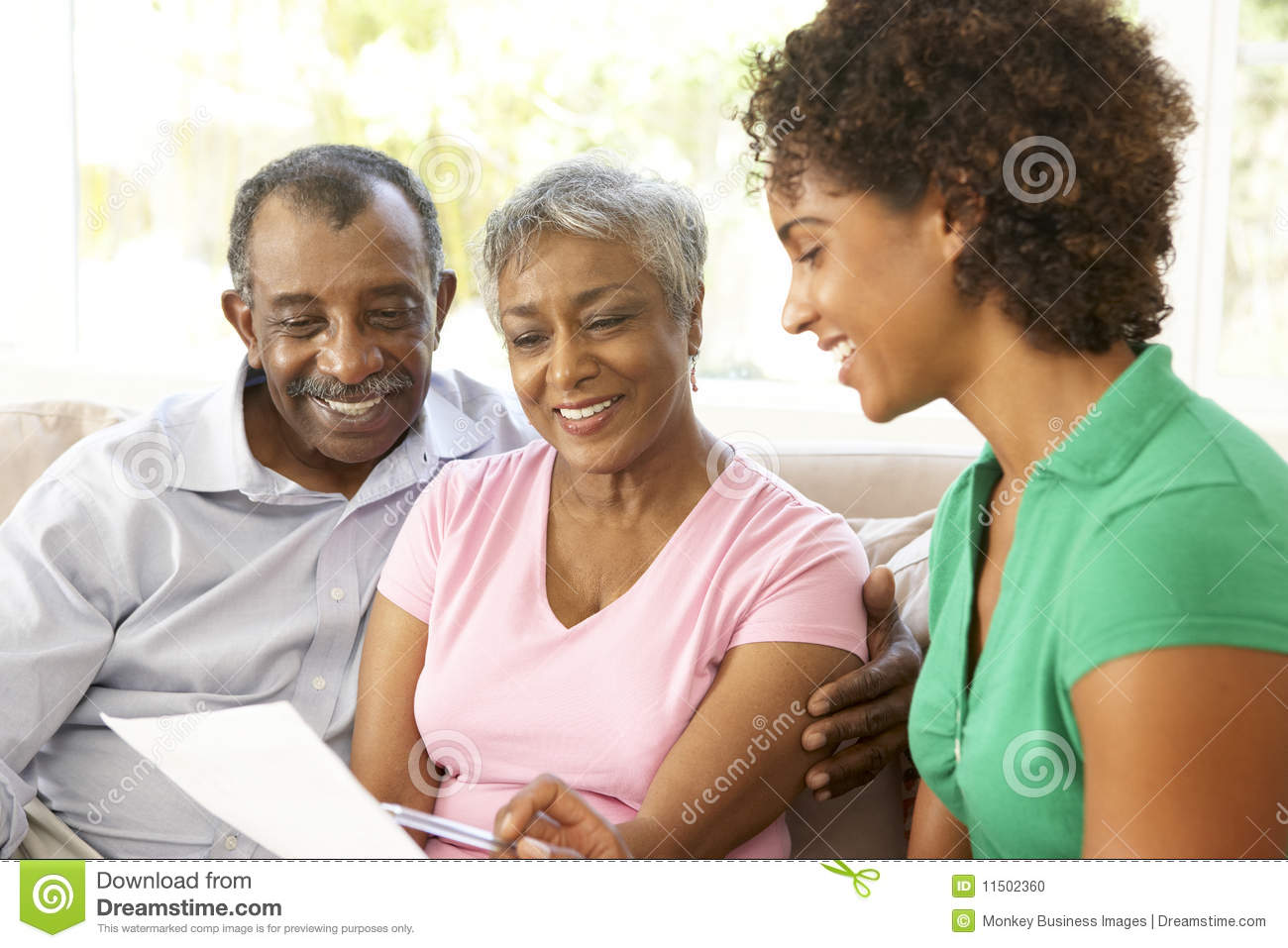 Senior Couple Talking To Financial Advisor
