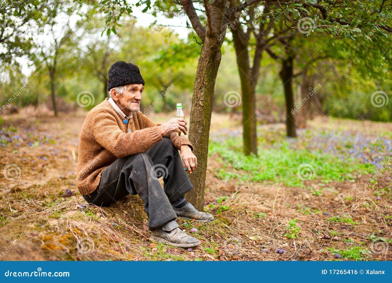 Senior Farmer Drinking Plum Brandy Royalty Free Stock