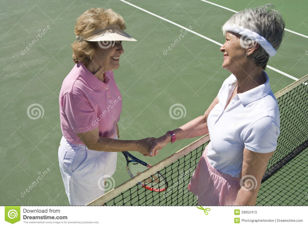 Senior Female Tennis Players Shaking Hands