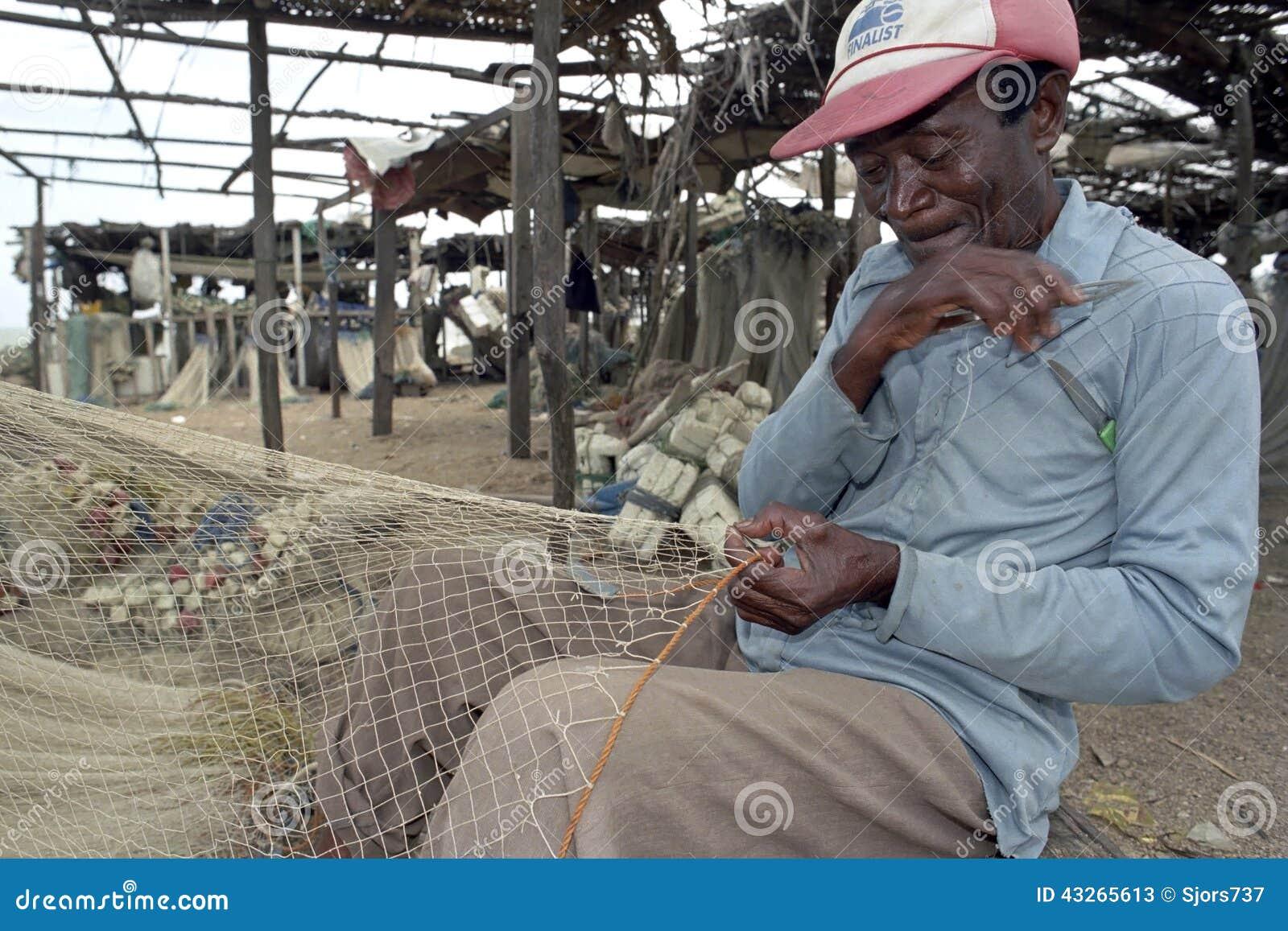 Senior fisherman sits to repair fishnet editorial stock for Senior fishing license