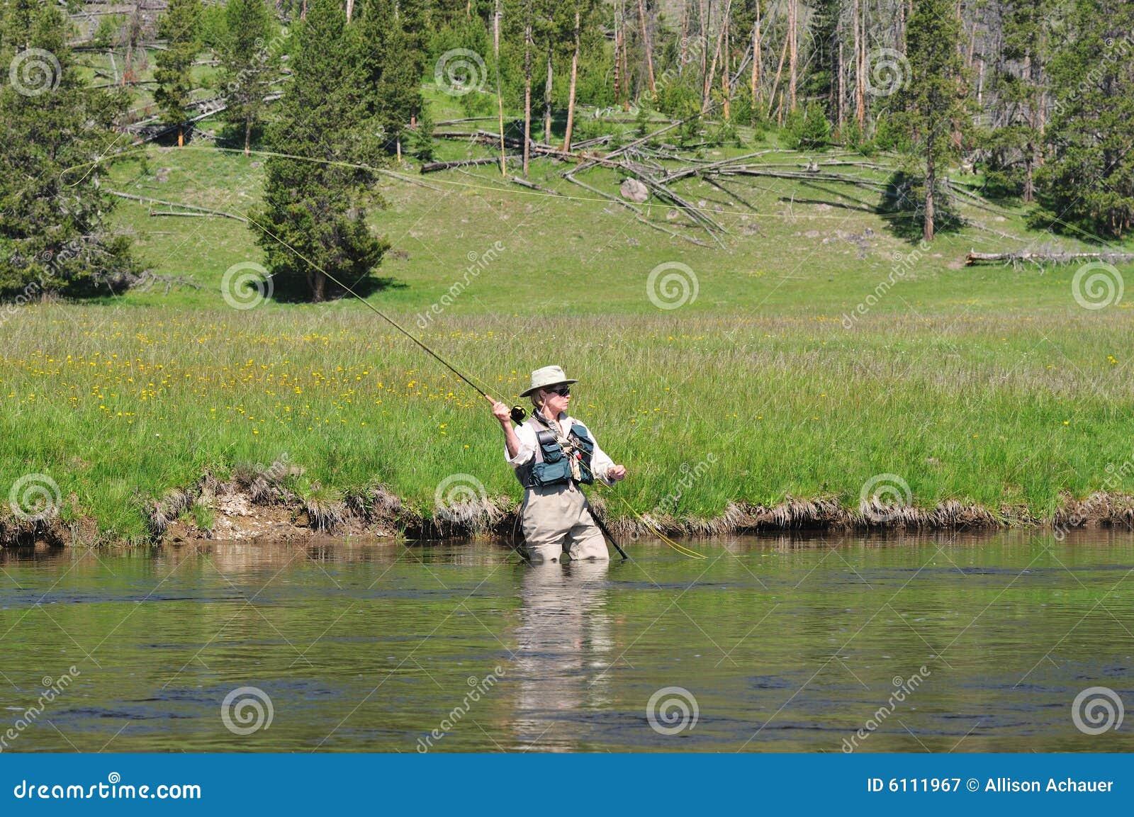 Senior fisherwoman casting