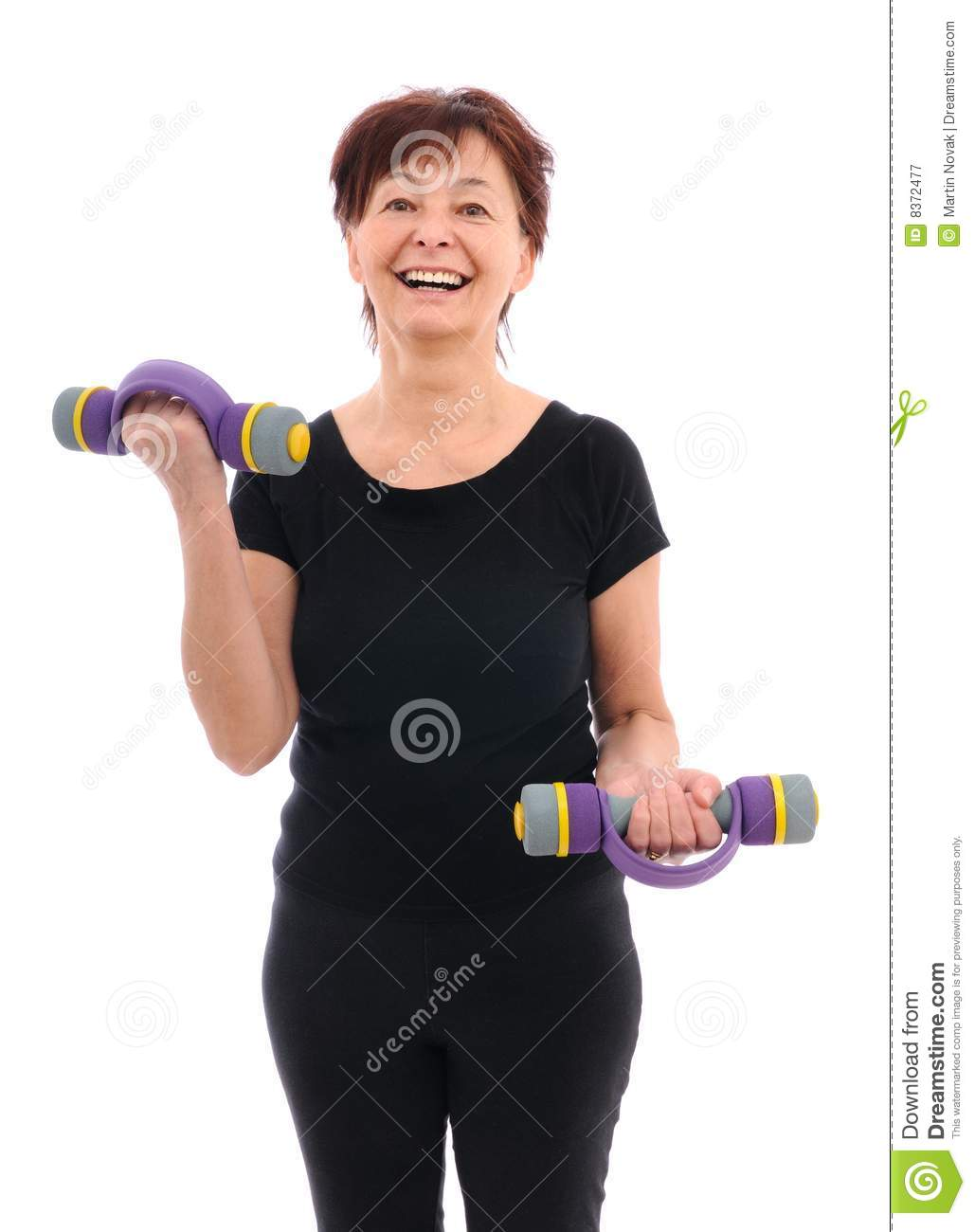Senior fitness woman with barbells
