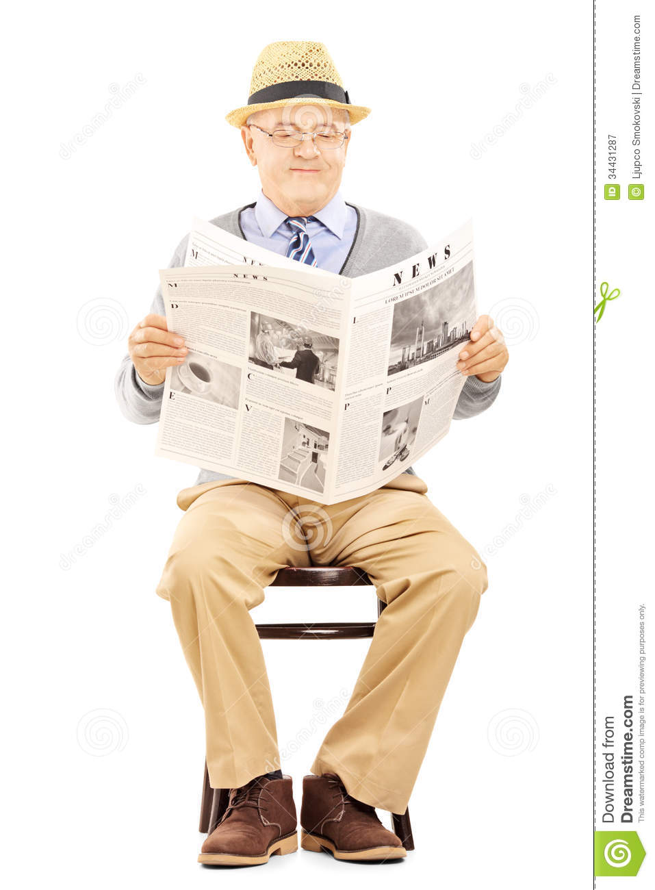 ... newspaper and sitting on a wooden chair isolated on white background