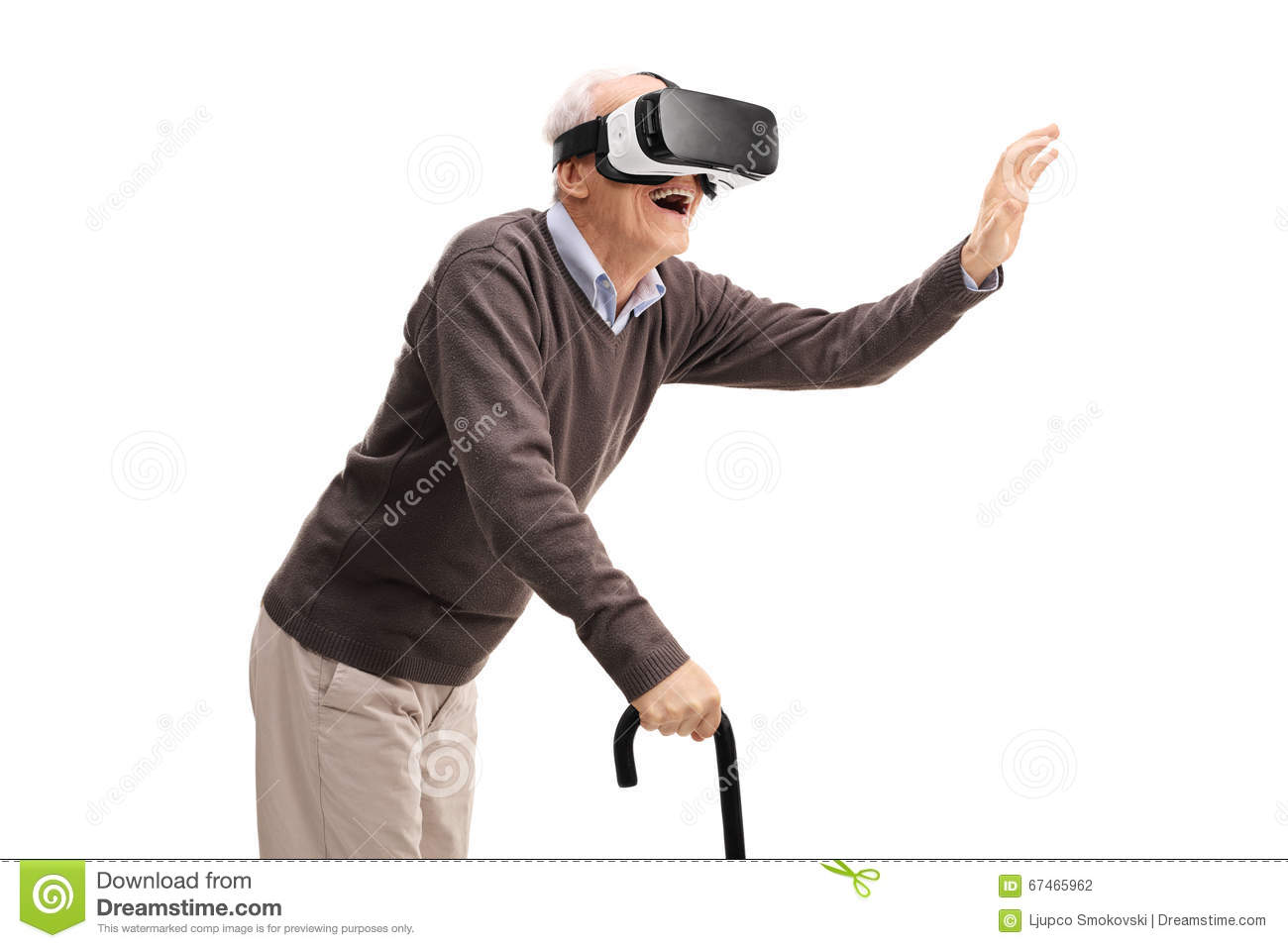 7f516db067 Senior gentleman with a cane having fun using a VR headset isolated on  white background
