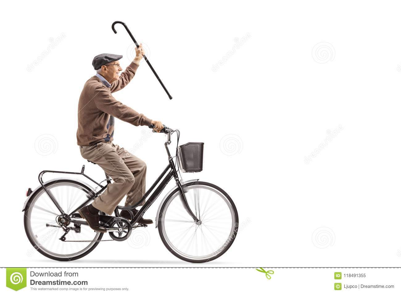Senior holding a cane and riding a bicycle