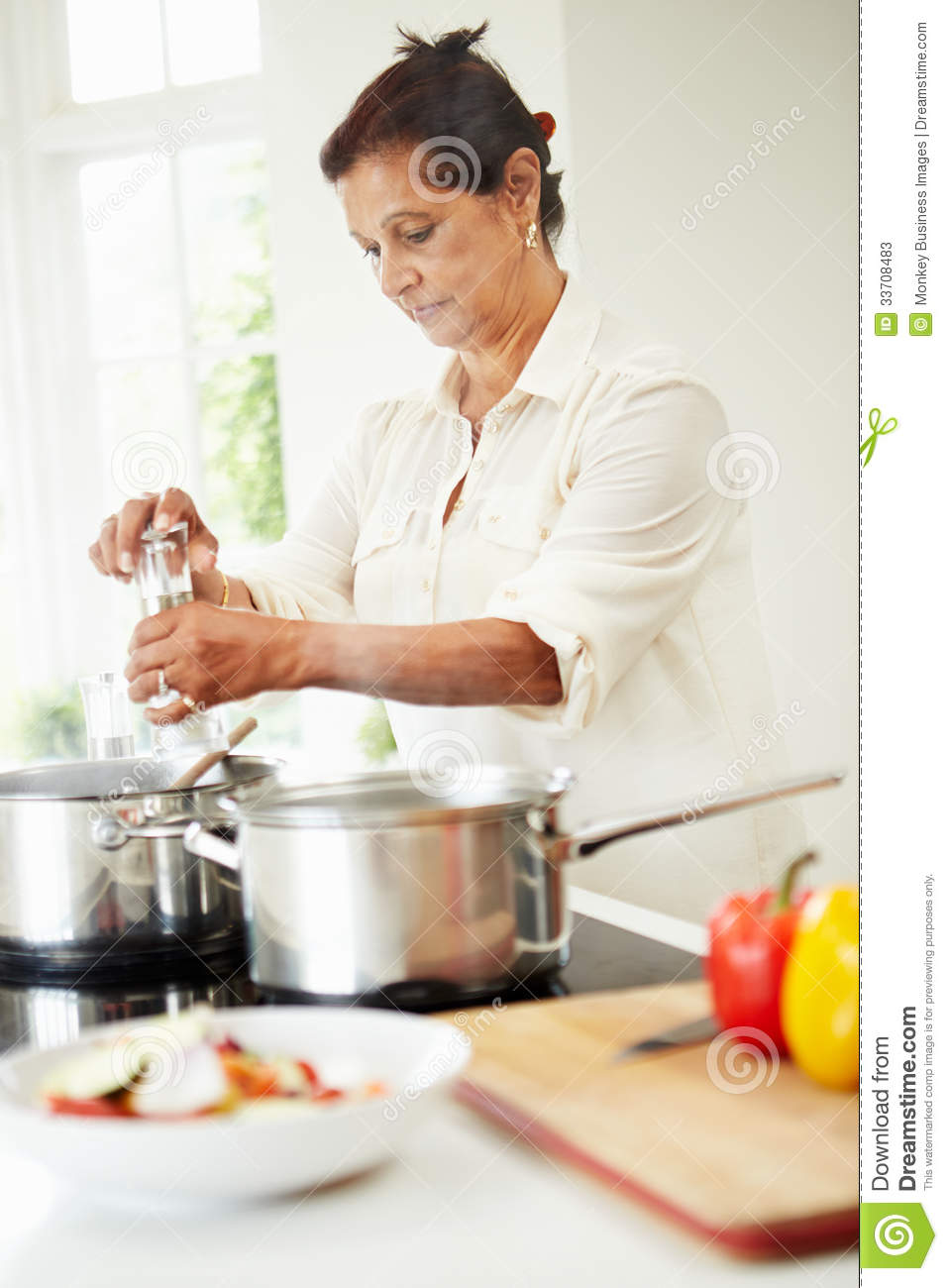 http://thumbs.dreamstime.com/z/senior-indian-woman-cooking-meal-home-kitchen-concentrating-33708483.jpg Indian Woman Cooking