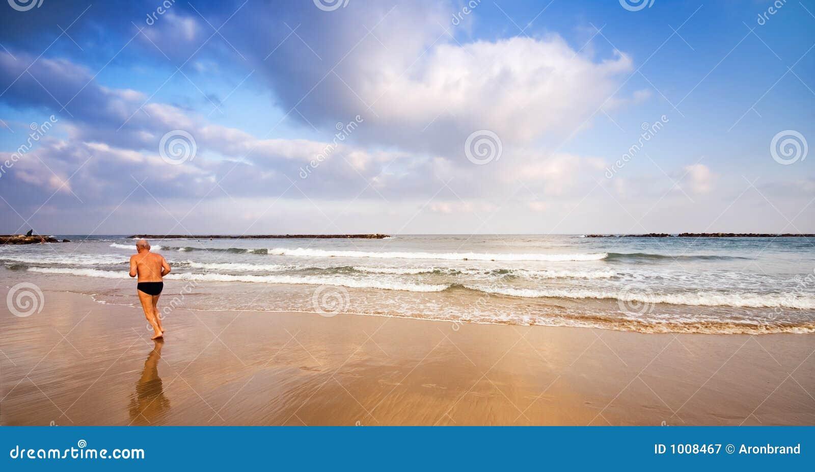 Senior jogging on the beach