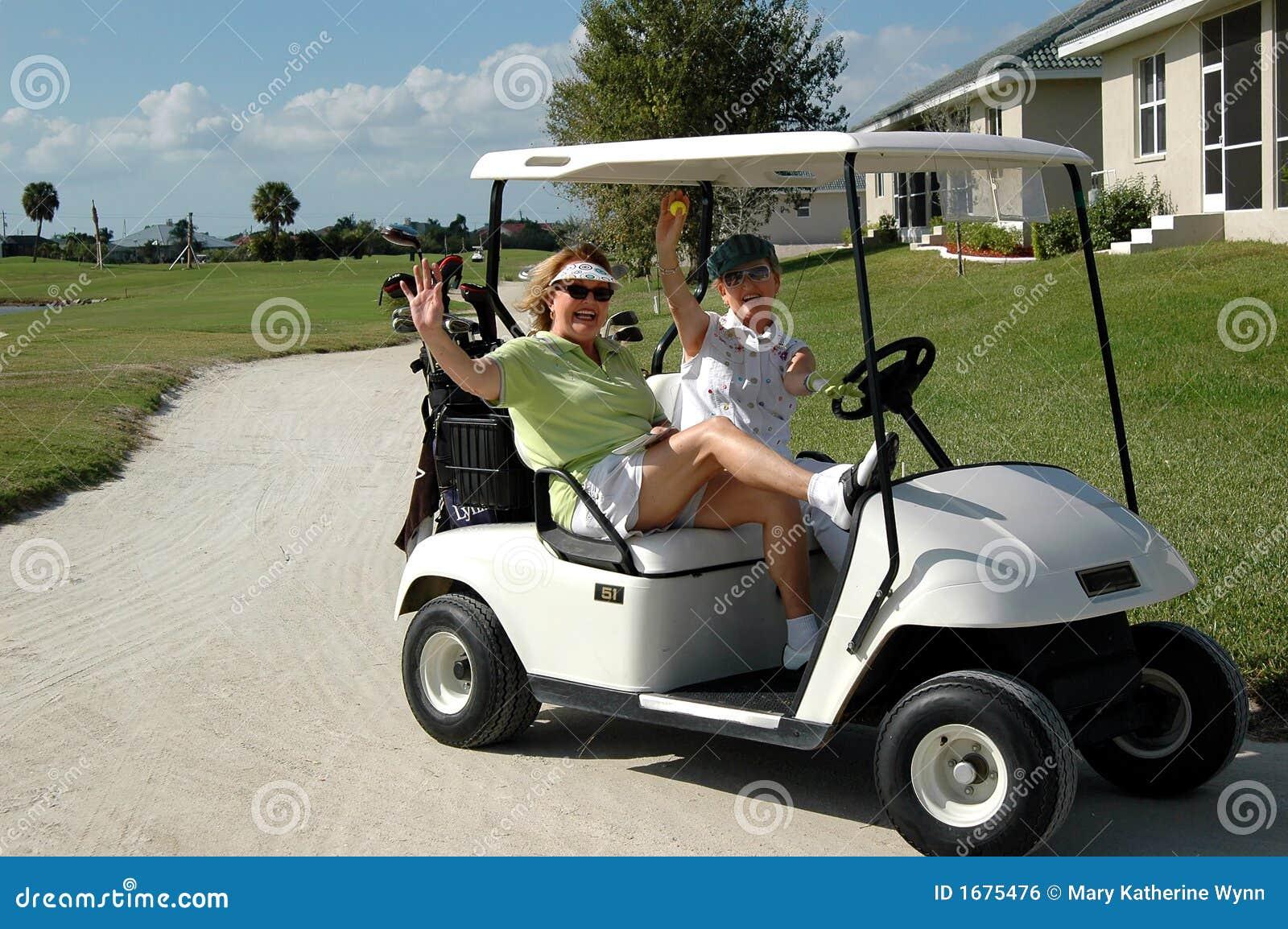 Senior ladies in golf cart royalty free stock image for Motorized cart for seniors