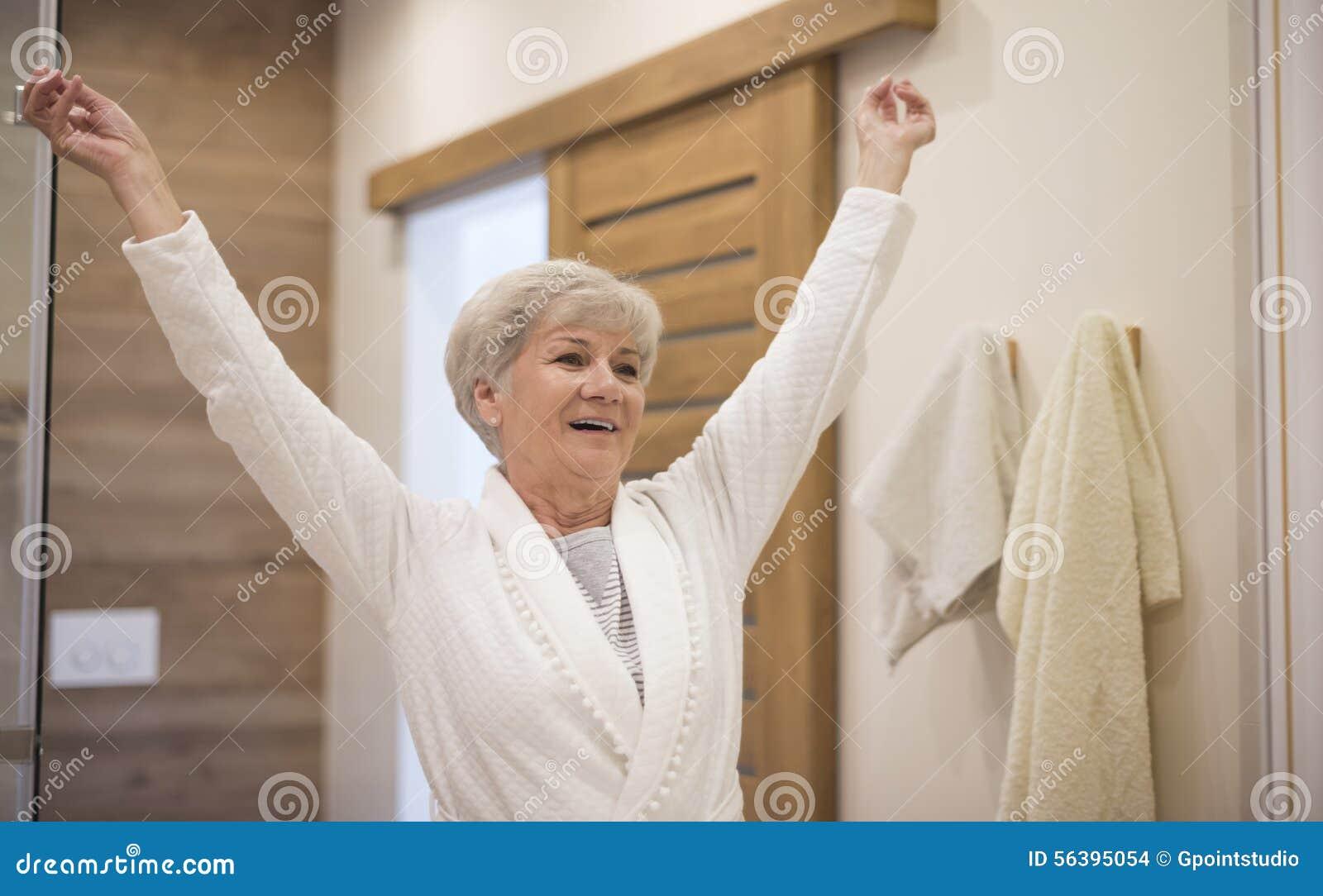 senior lady in the bathroom stock photo image 56395054