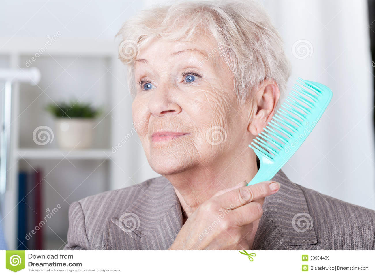 Senior Lady Combing Hair Royalty Free Stock Images - Image: 38384439