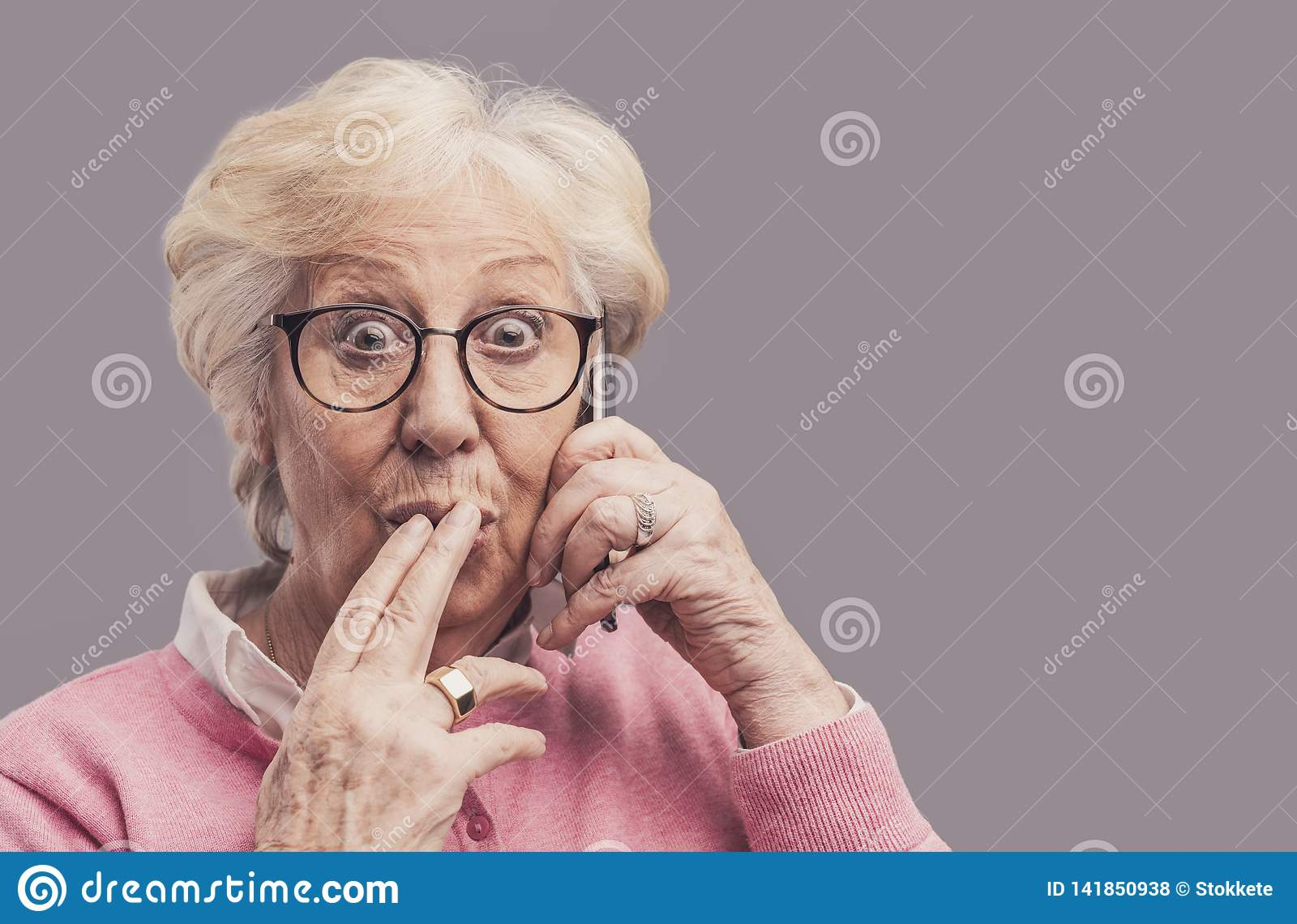 Senior lady gossiping on the phone