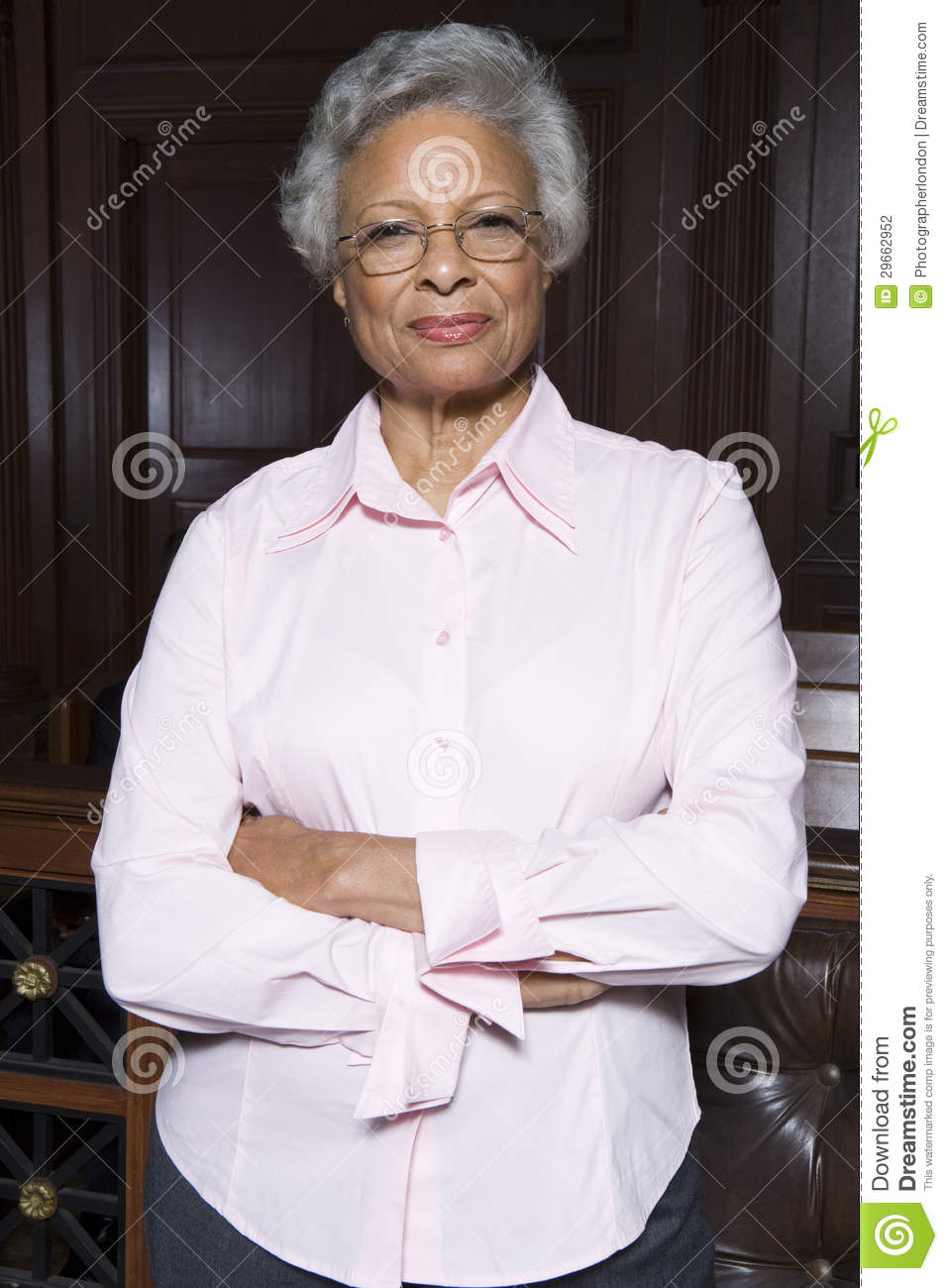 Senior Lawyer Standing With Hands Folded