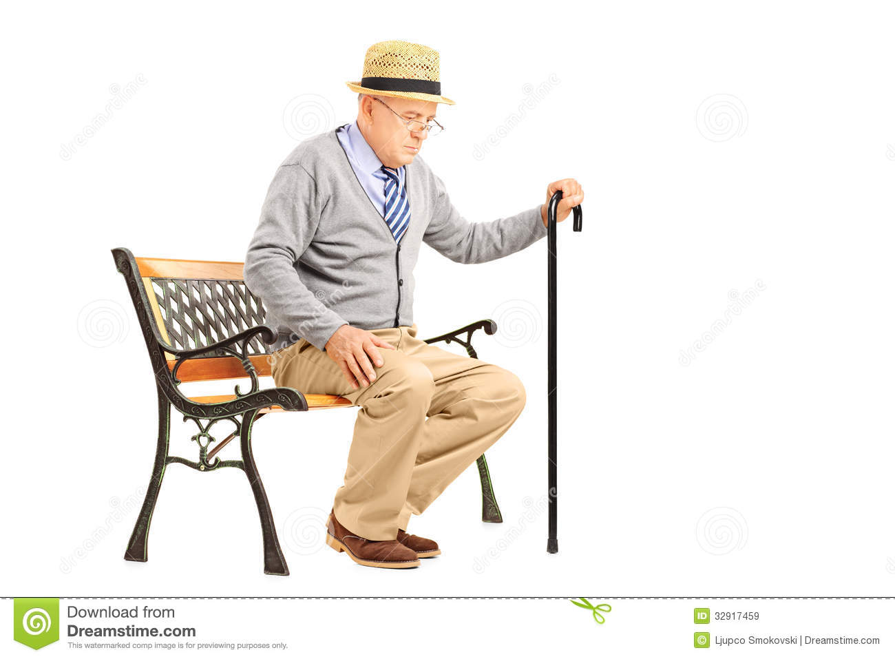 senior man with a cane sitting on a bench stock image