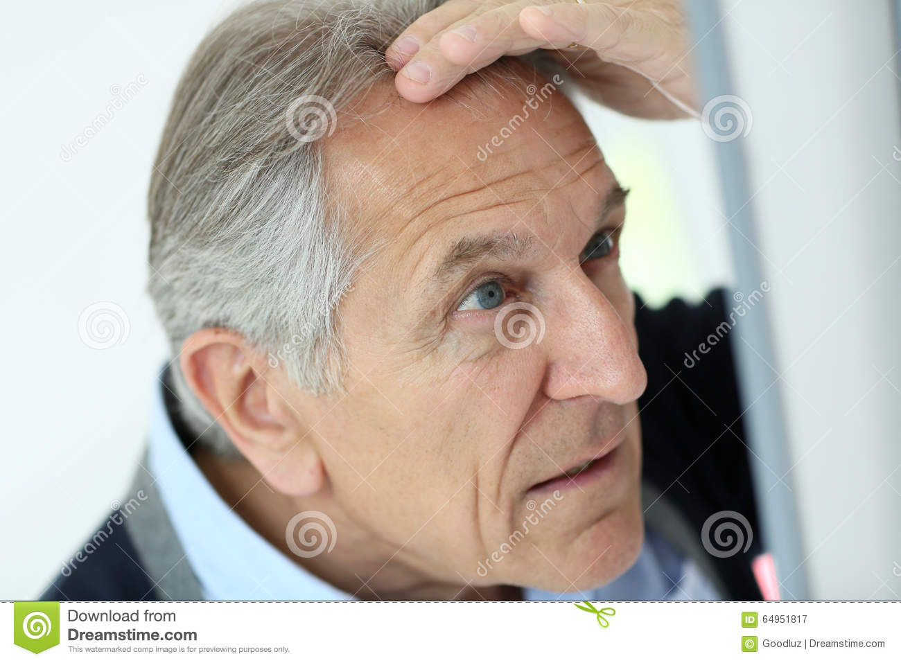 Senior man concerned about hair loss