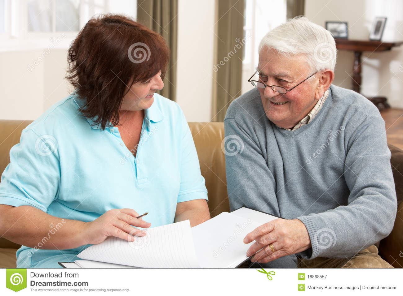 Senior Man In Discussion With Health Visitor At Ho