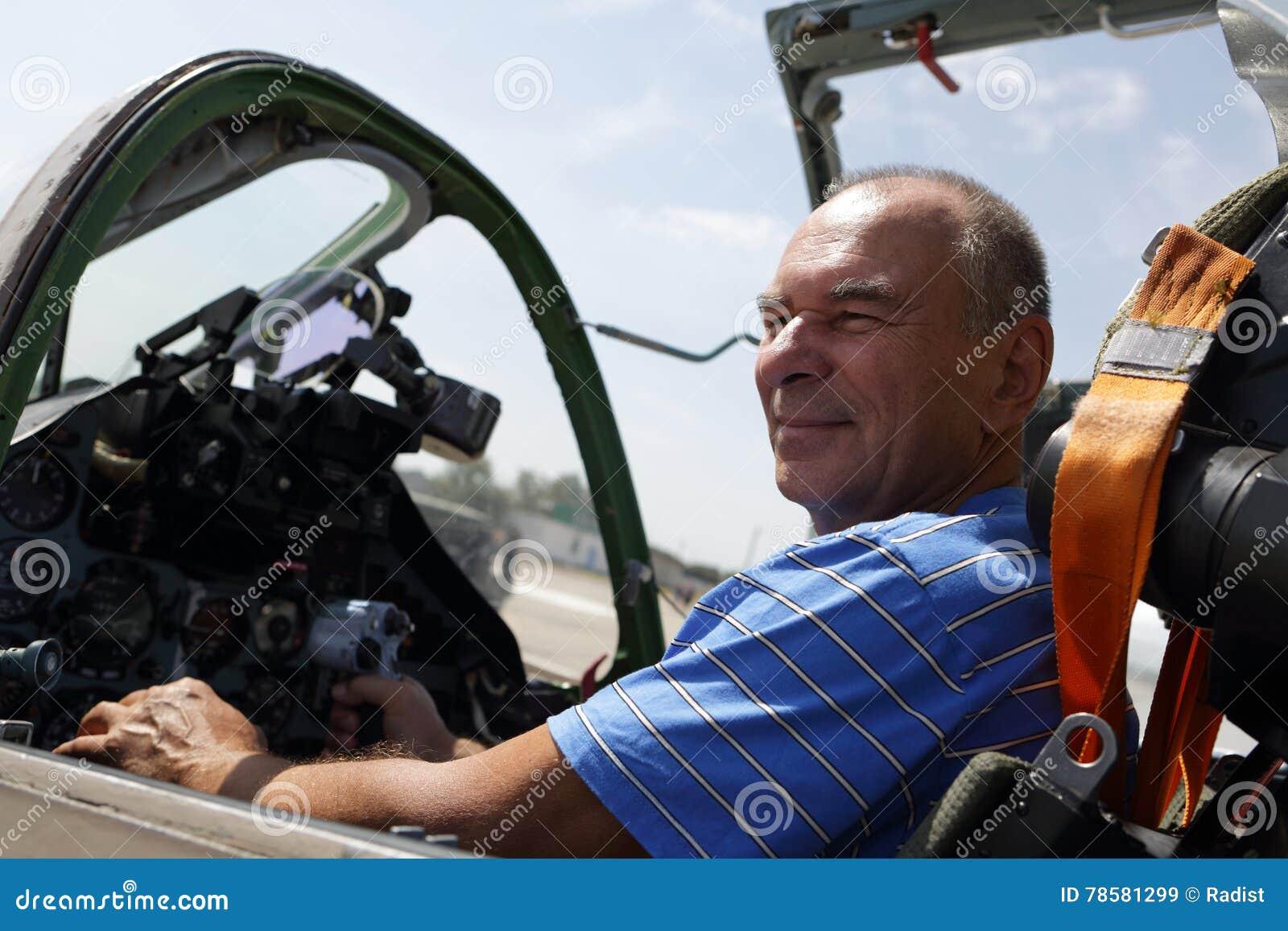 Senior man in fighter cockpit