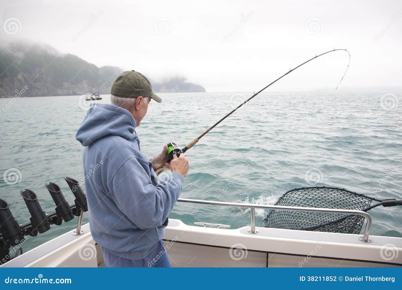 Senior man fishing for salmon in Alaska
