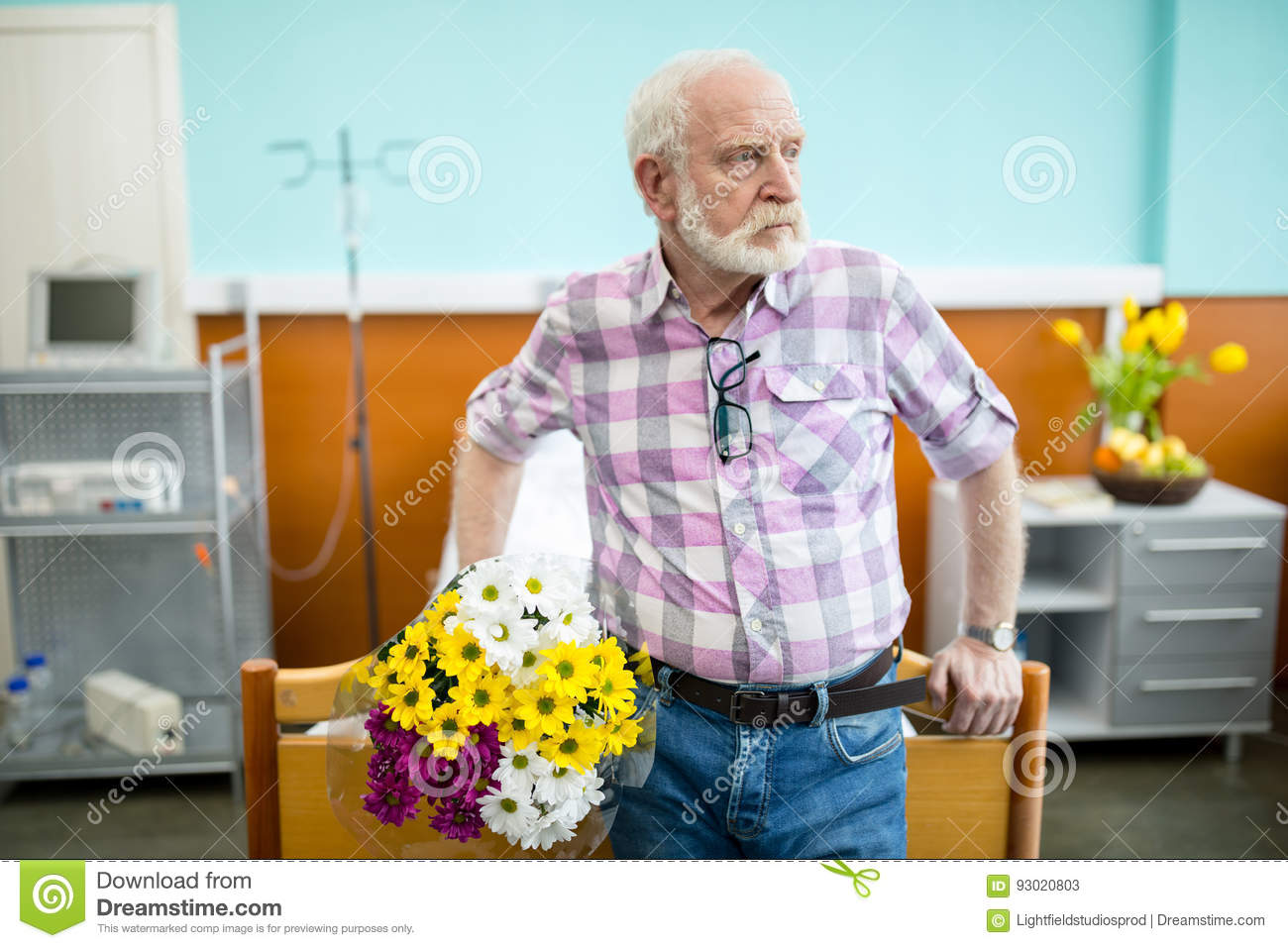 Senior Man With Flowers In Hospital Stock Image