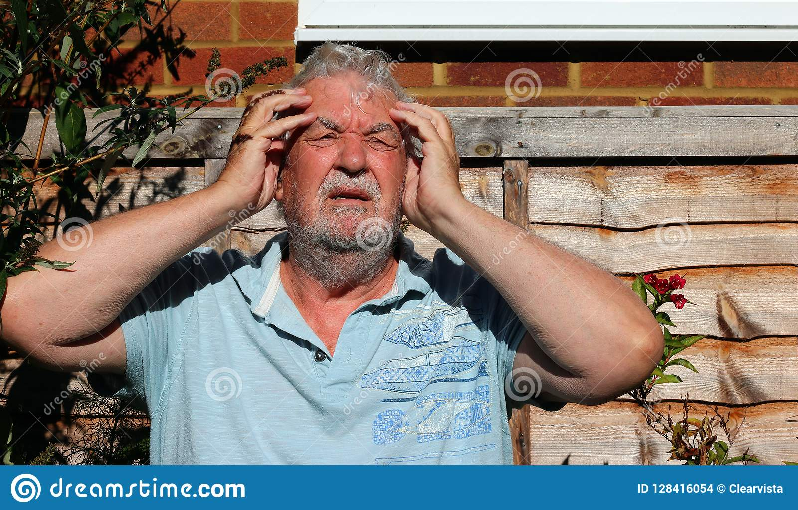 Headache or migraine. Man holding his head in pain.