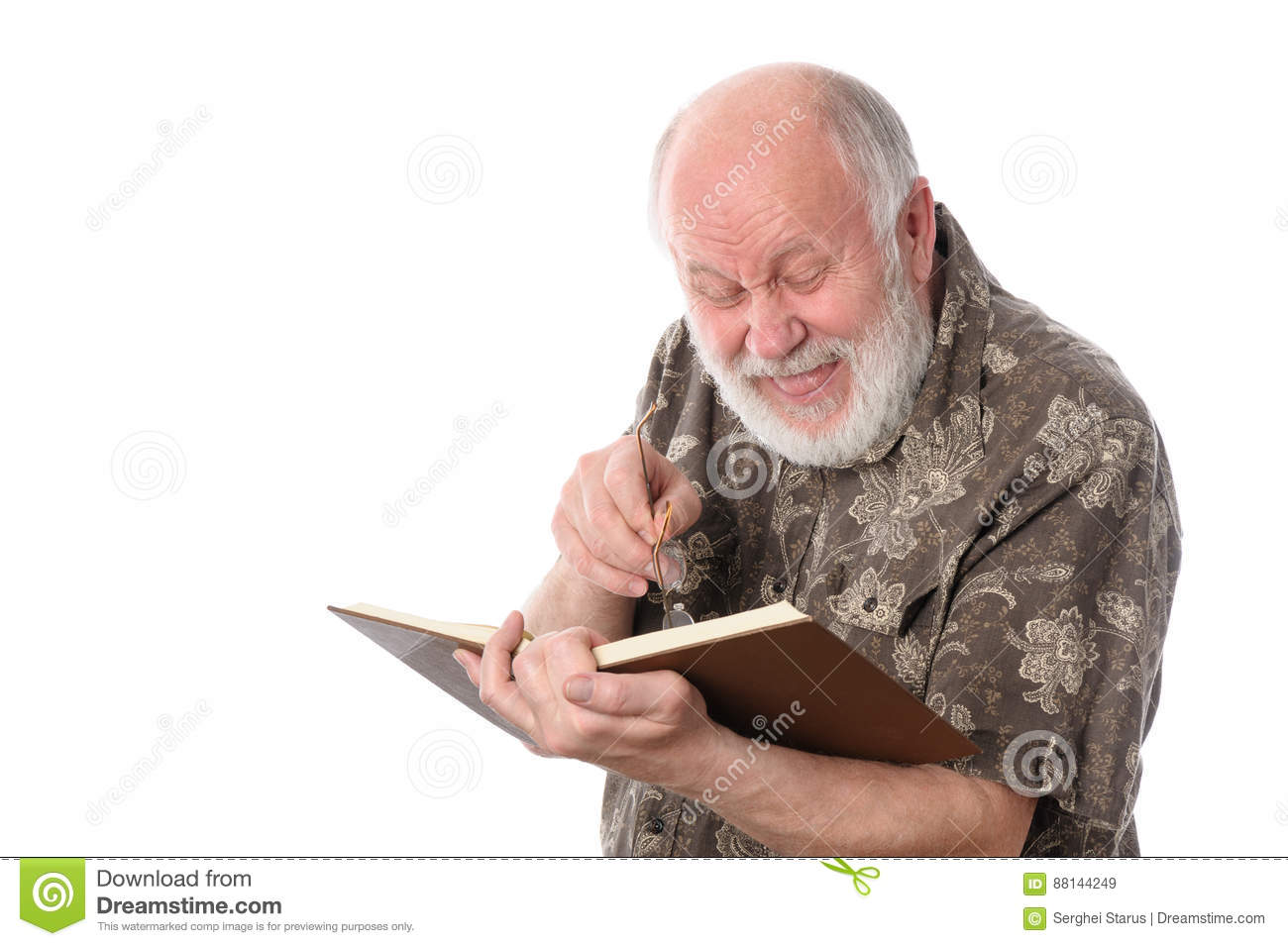Senior man laughing while reading a book, isolated on white