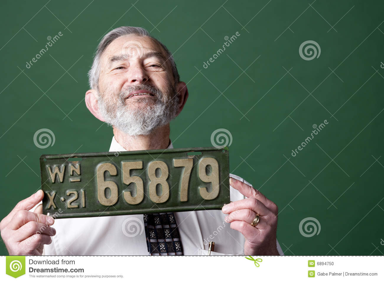 Senior man with license plate