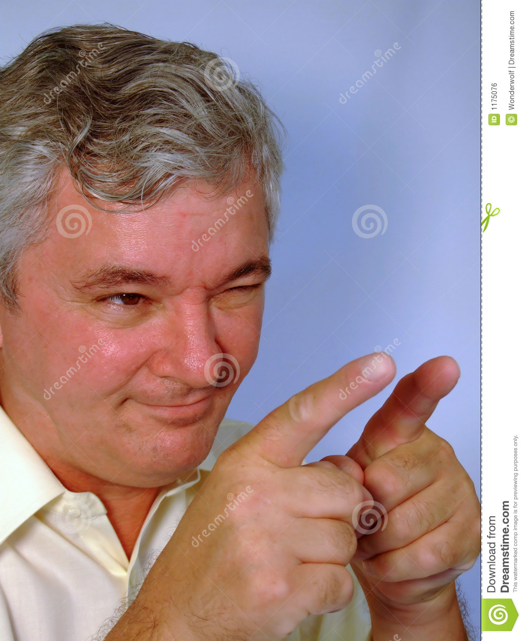 Senior Man Pointing, Winking And Smiling Royalty Free ...