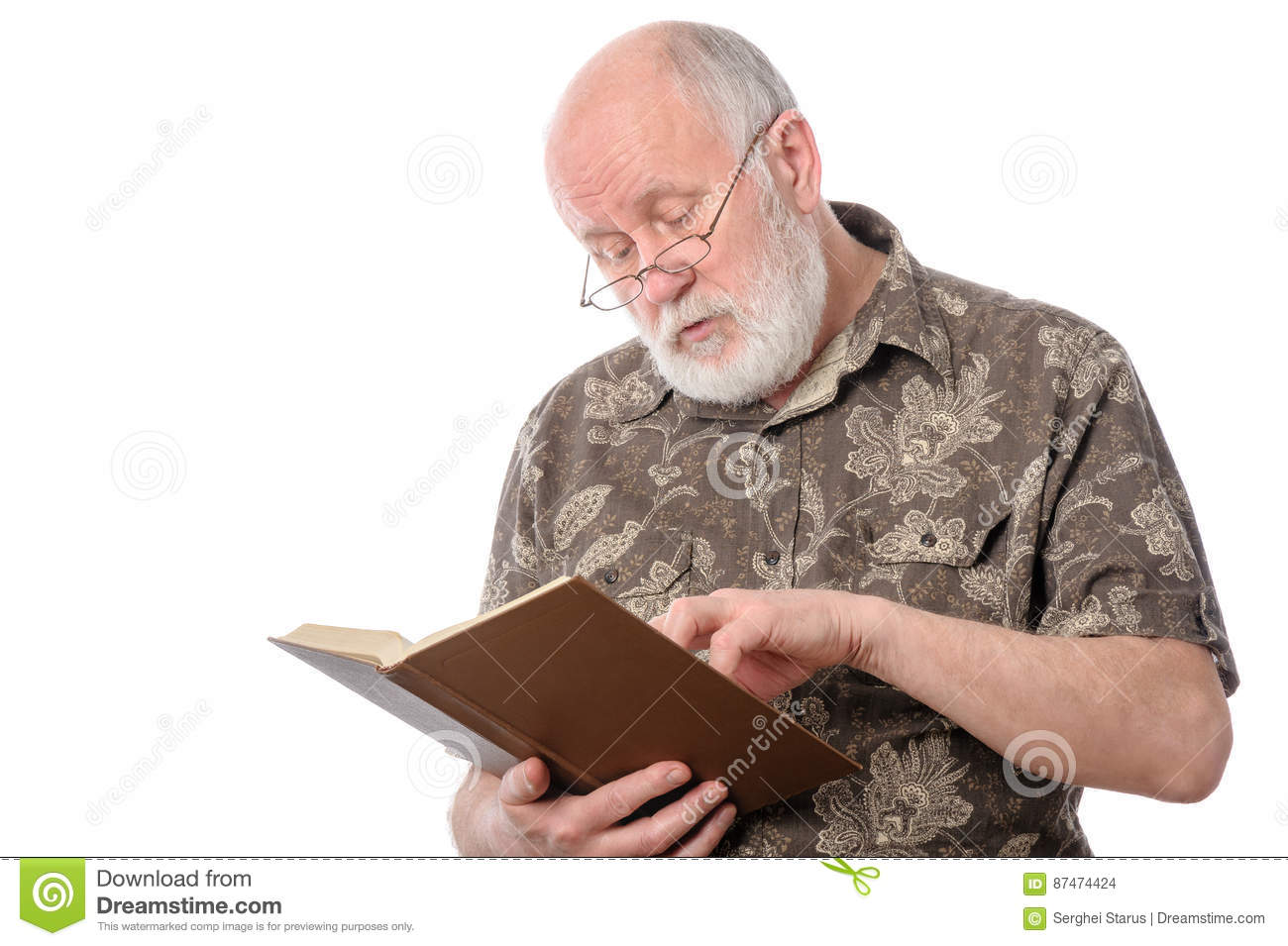 Senior man reading a book, isolated on white