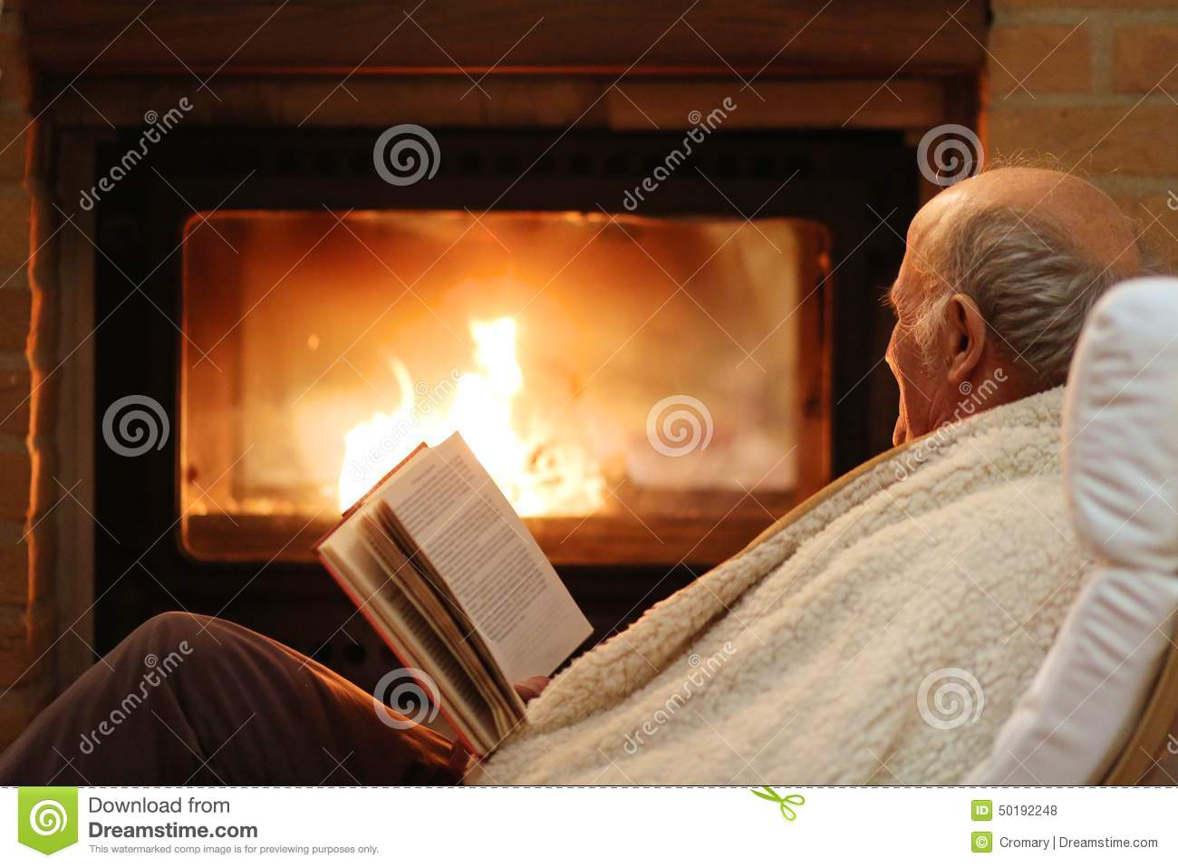 Senior Man Relaxing By Fireplace Stock Photo Image 50192248