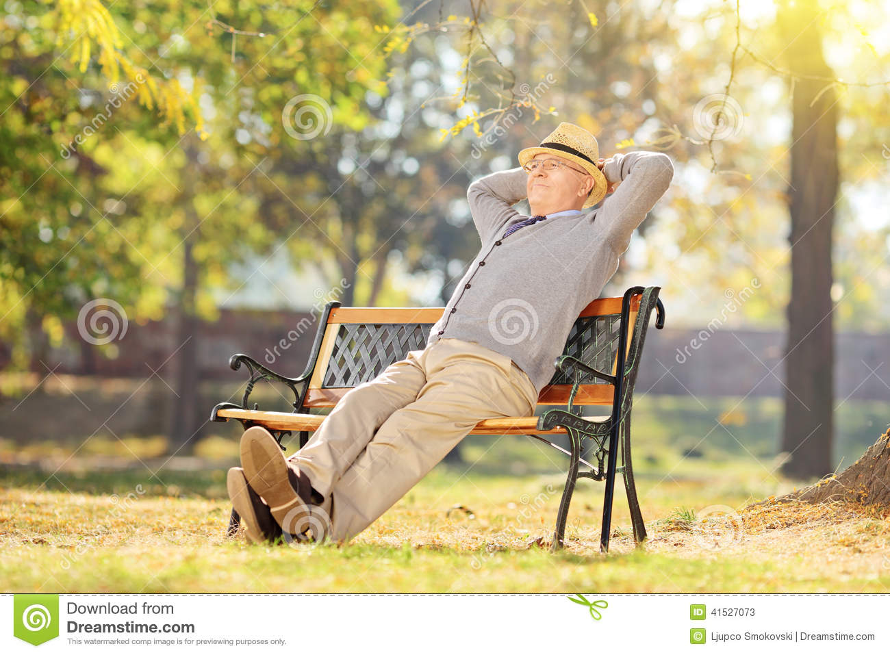 Senior Man Relaxing In Park On A Sunny Day Stock Photo