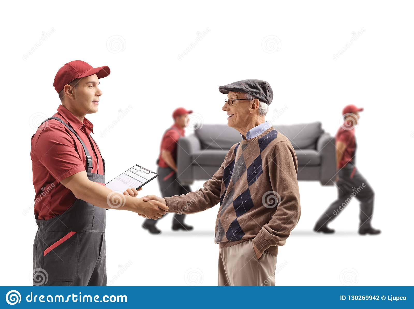 Senior man shaking hands with a mover, movers carrying a couch i