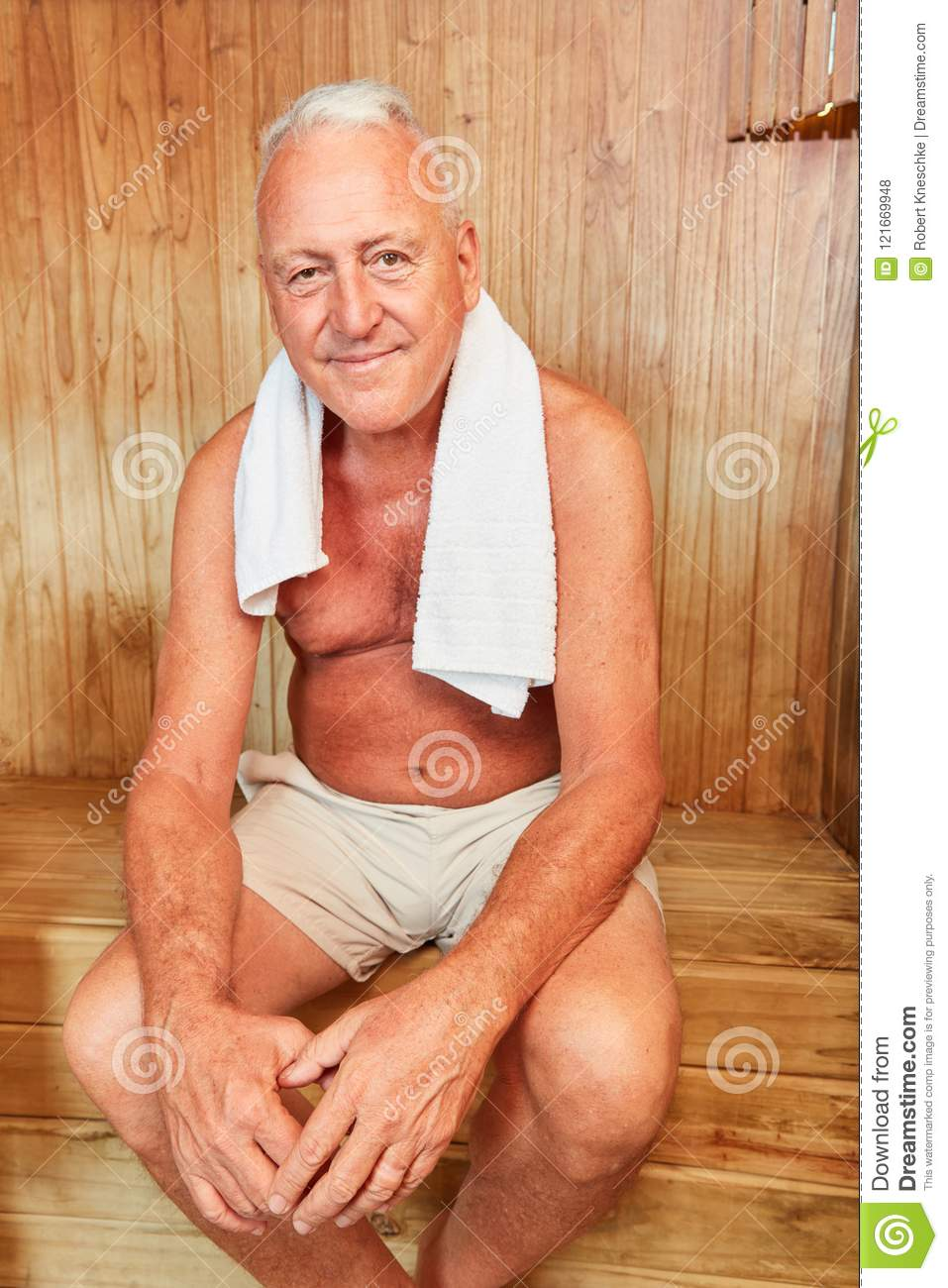 Senior man sits relaxed in the sauna