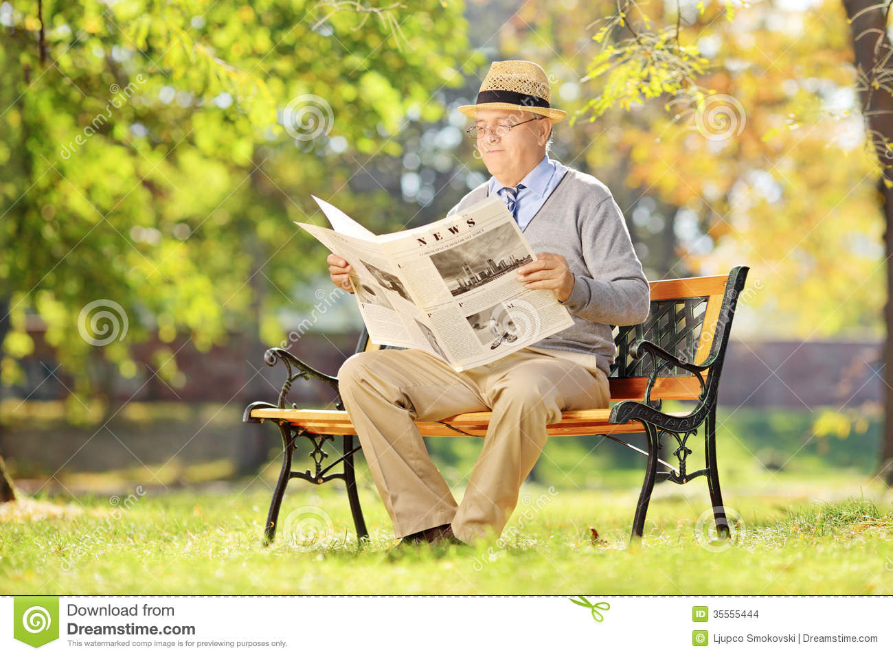 Super Senior Man Sitting On A Bench And Reading A Newspaper In Evergreenethics Interior Chair Design Evergreenethicsorg