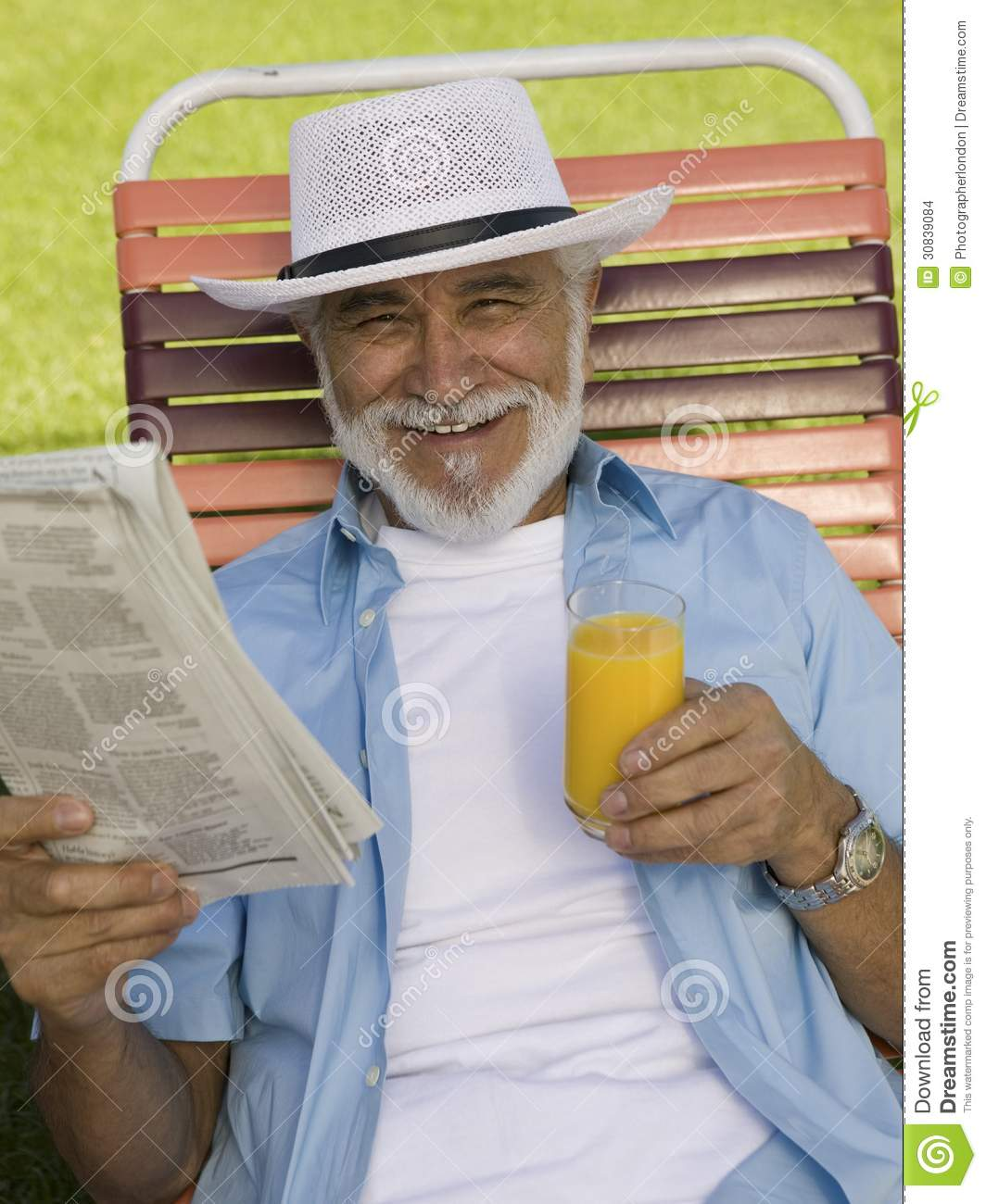 Outdoor Patio Furniture For Seniors: Senior Man Sitting On Lawn Chair Holding Newspaper And