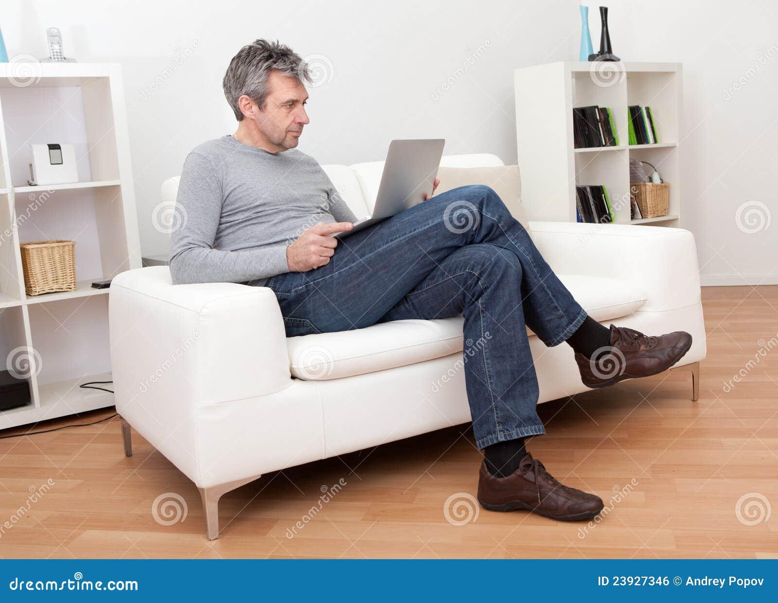 Senior Man Sitting In Sofa And Using Laptop Royalty Free ...