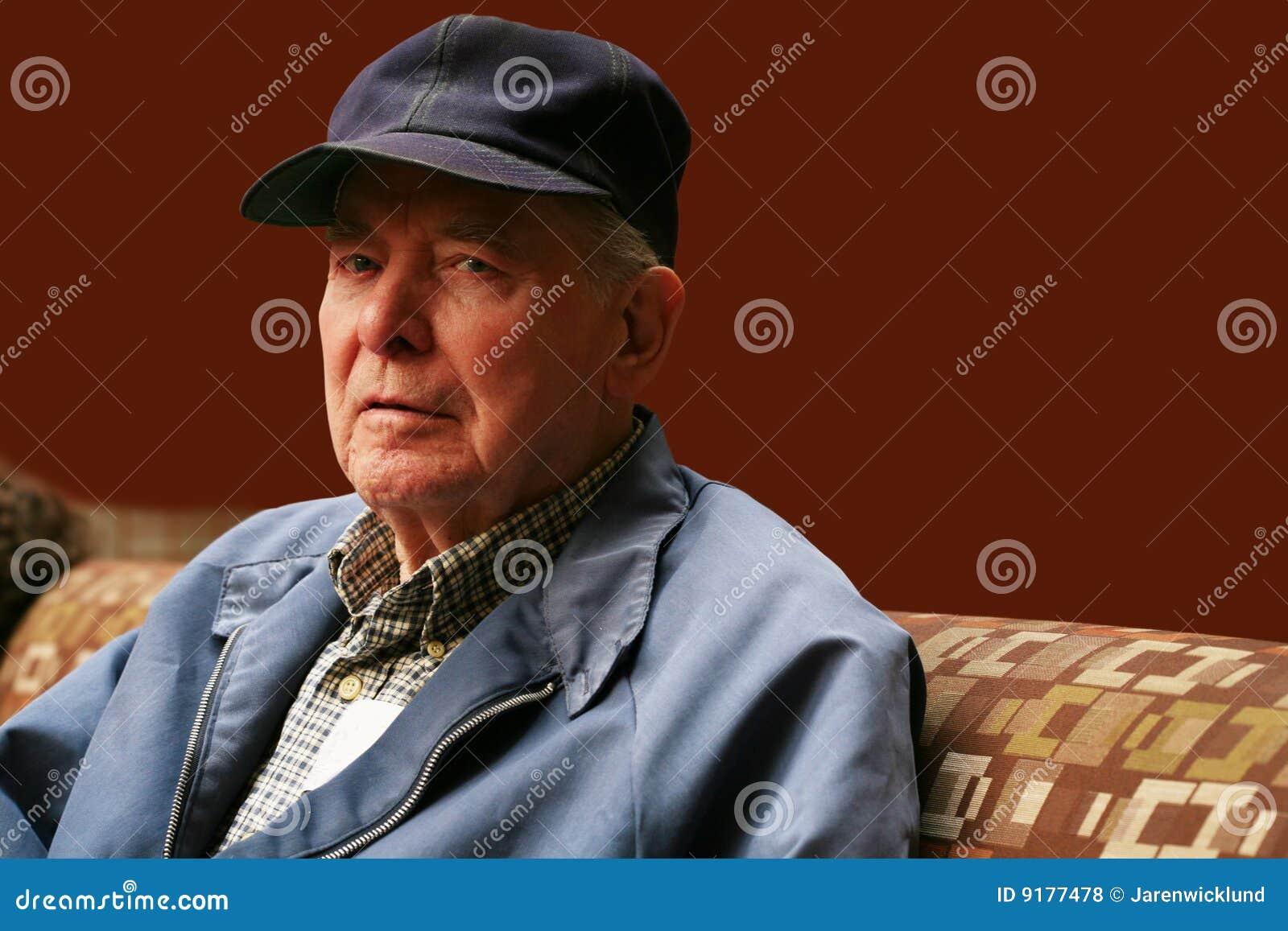 Senior man sitting in waiting room