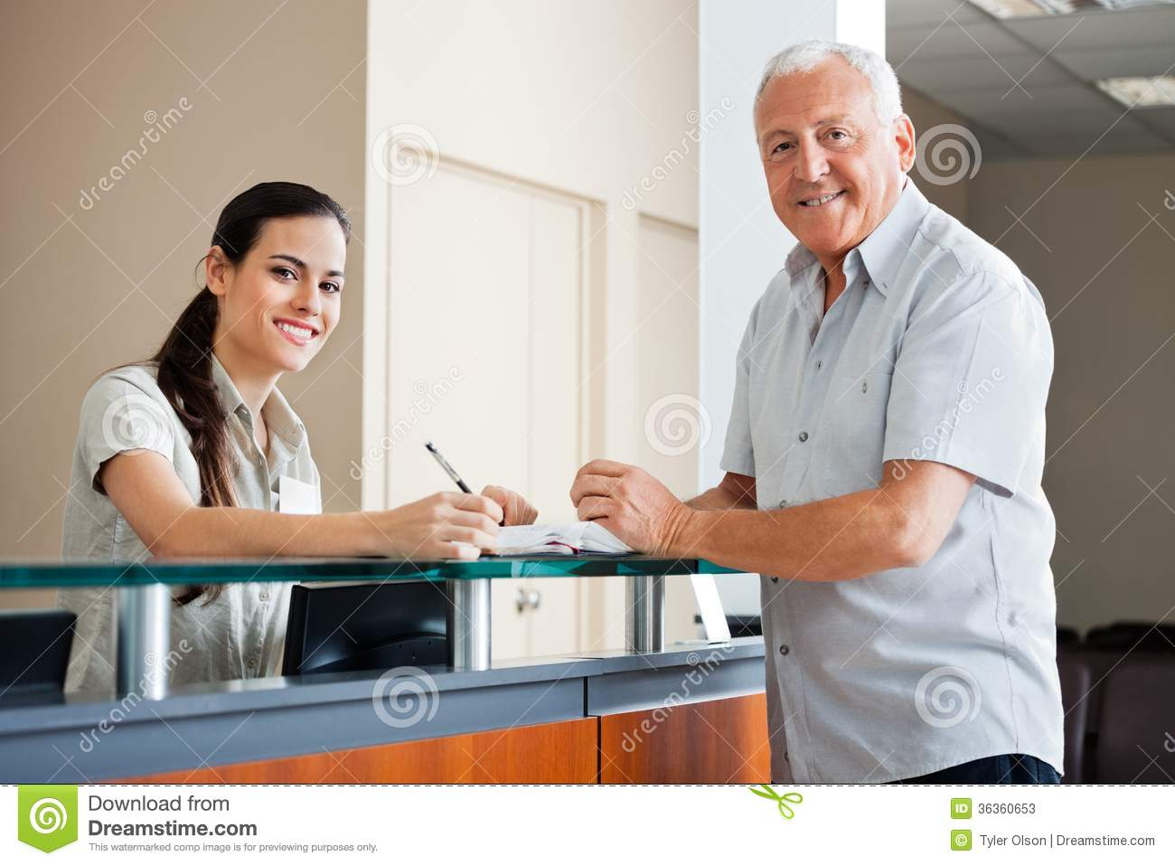 Senior Man Standing At Hospital Reception Stock Photos