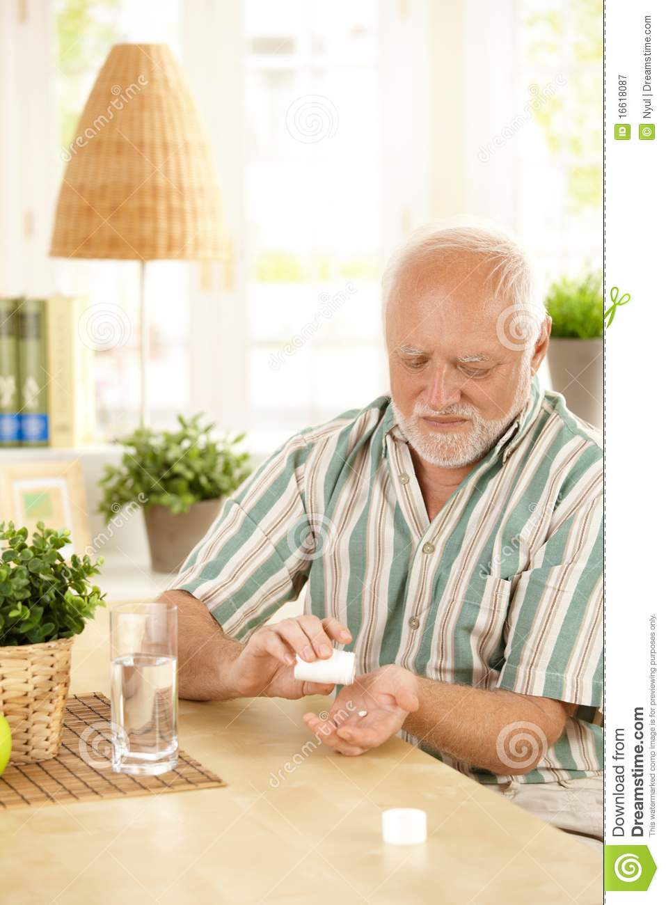 Senior Man Taking Medication At Home Royalty Free Stock ...