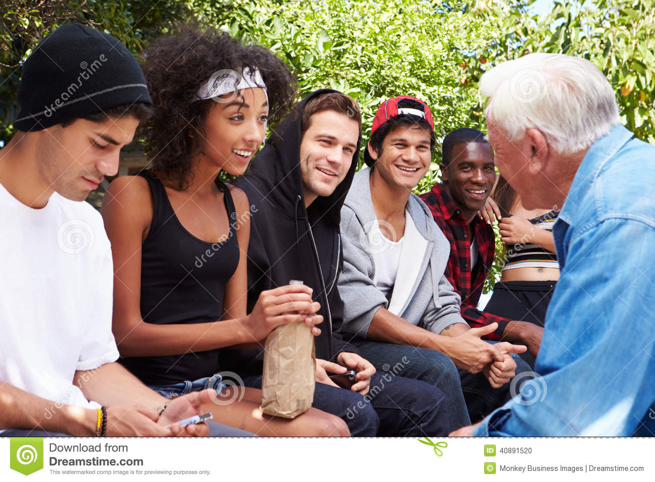 Senior Man Talking With Gang Of Young People Stock Photo - Image ...